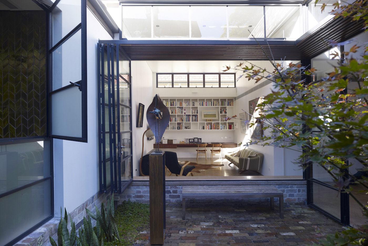 Smee Schoff House by Sam Crawford Architects, view to living space from backyard