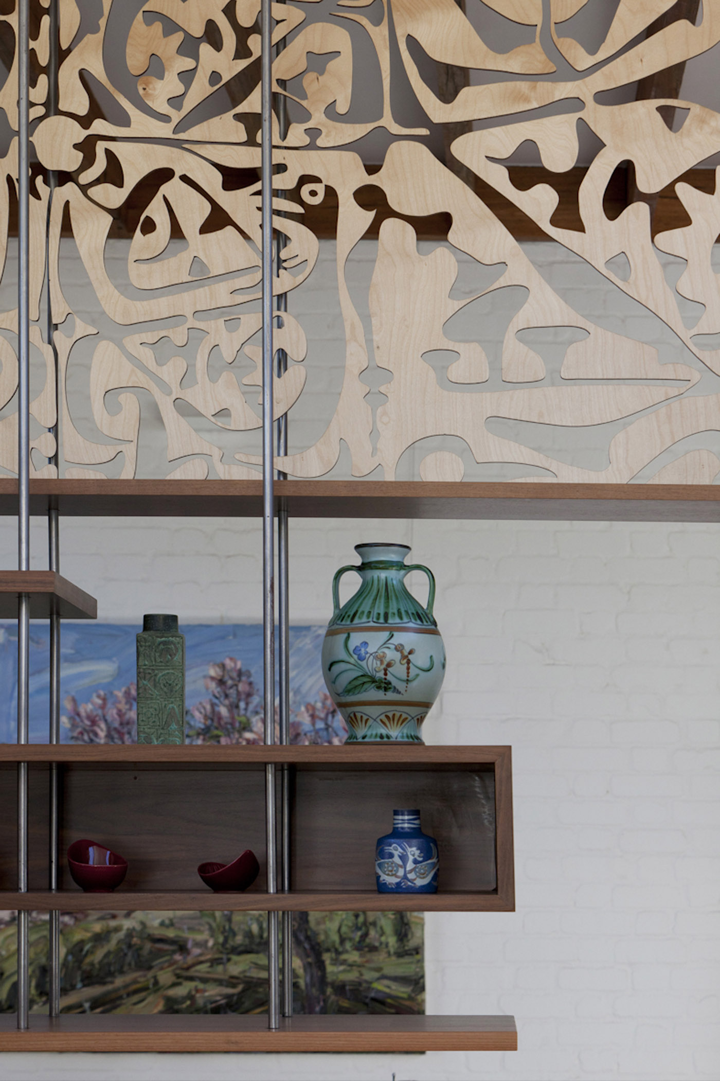 Smee Schoff House by award winning Sydney residential architecture firm Sam Crawford Architects. Detail of suspended shelf with timber laser cut screen