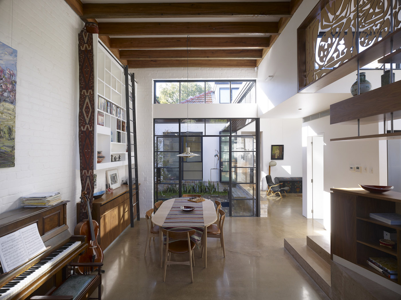 Smee Schoff House by Sam Crawford Architects, view to the light filled white and timber interior with double height ceiling