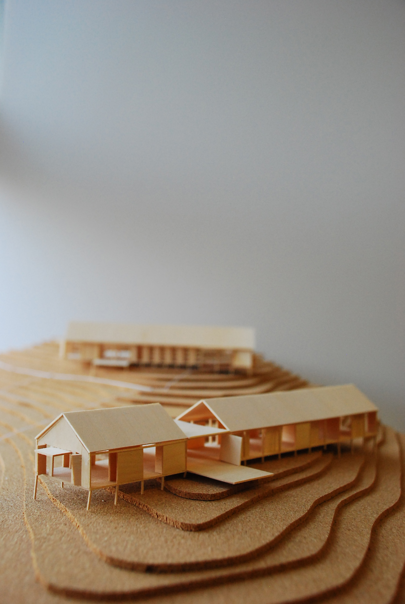 Gloucester Farmhouse by award winning residential architecture firm Sam Crawford Architects. Balsa wood house model on cork sheets contours