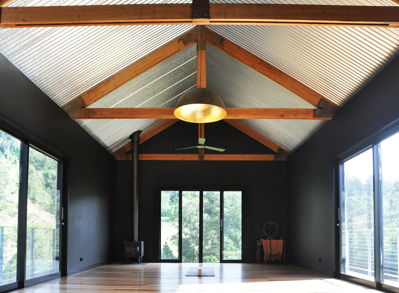 Gloucester Farmhouse by award winning residential architecture firm Sam Crawford Architects. Exposed structure and strong material palette brings an industrial feel to the farmhouse's interior