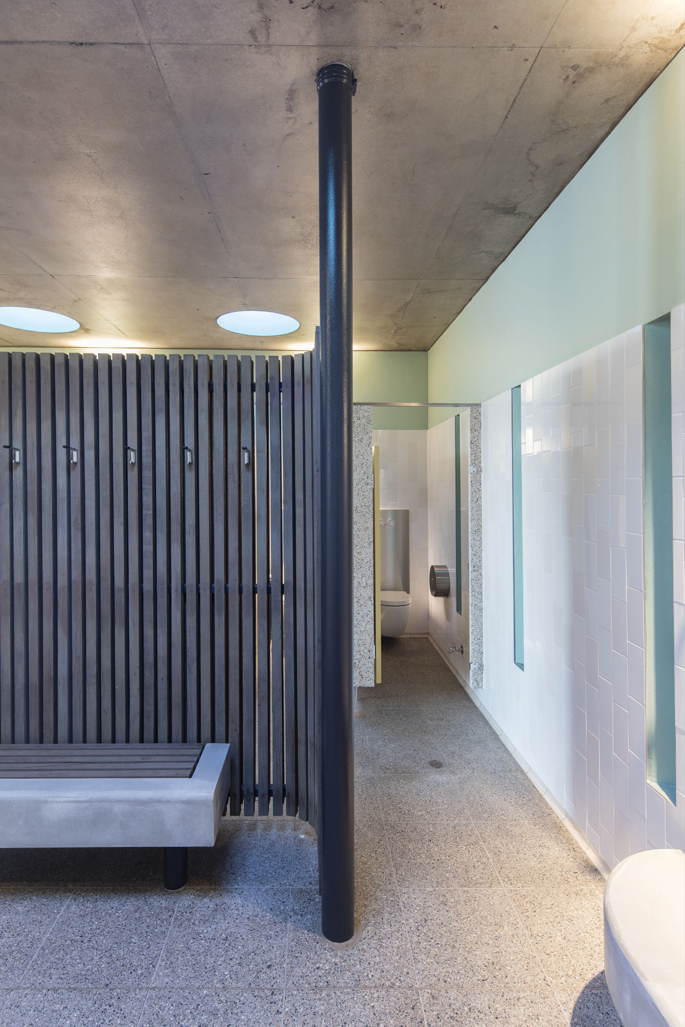 North Bondi Amenities, a public project by award winning Sam Crawford Architects. Interior change rooms use timber screens.