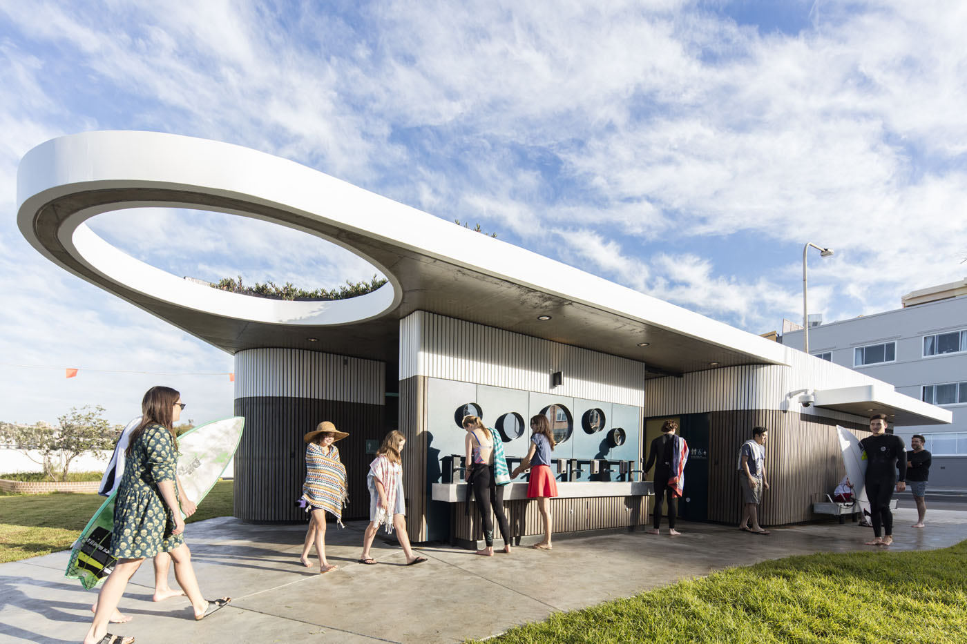North Bondi Amenities, a public project by award winning Sam Crawford Architects. Hand wash basin in use.
