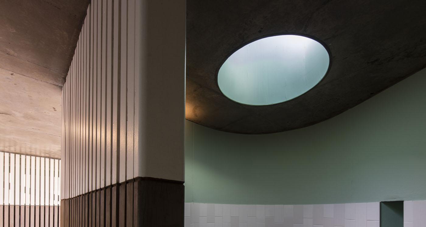 North Bondi Amenities, a public project by award winning Sam Crawford Architects. Round skylights produce amazing light quality.