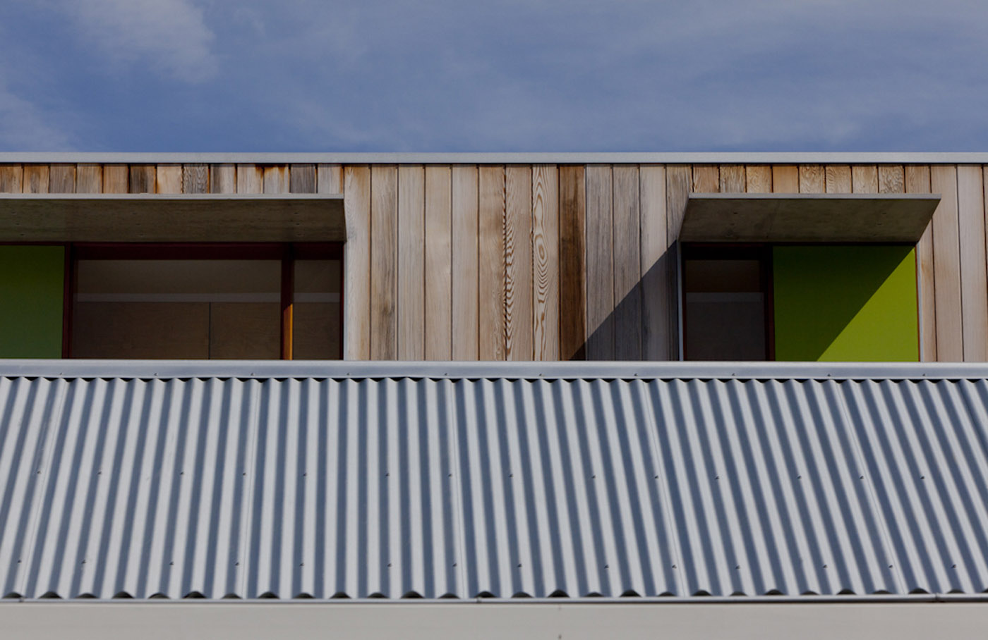 Campbell House by award winning Sydney residential architecture firm Sam Crawford Architects. New addition with flat window overhang and coloured panels