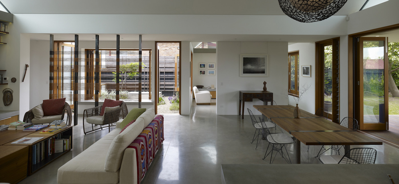 Garrett House by Sydney award winning architecture office Sam Crawford Architects. Open plan living and kitchen with gable roof
