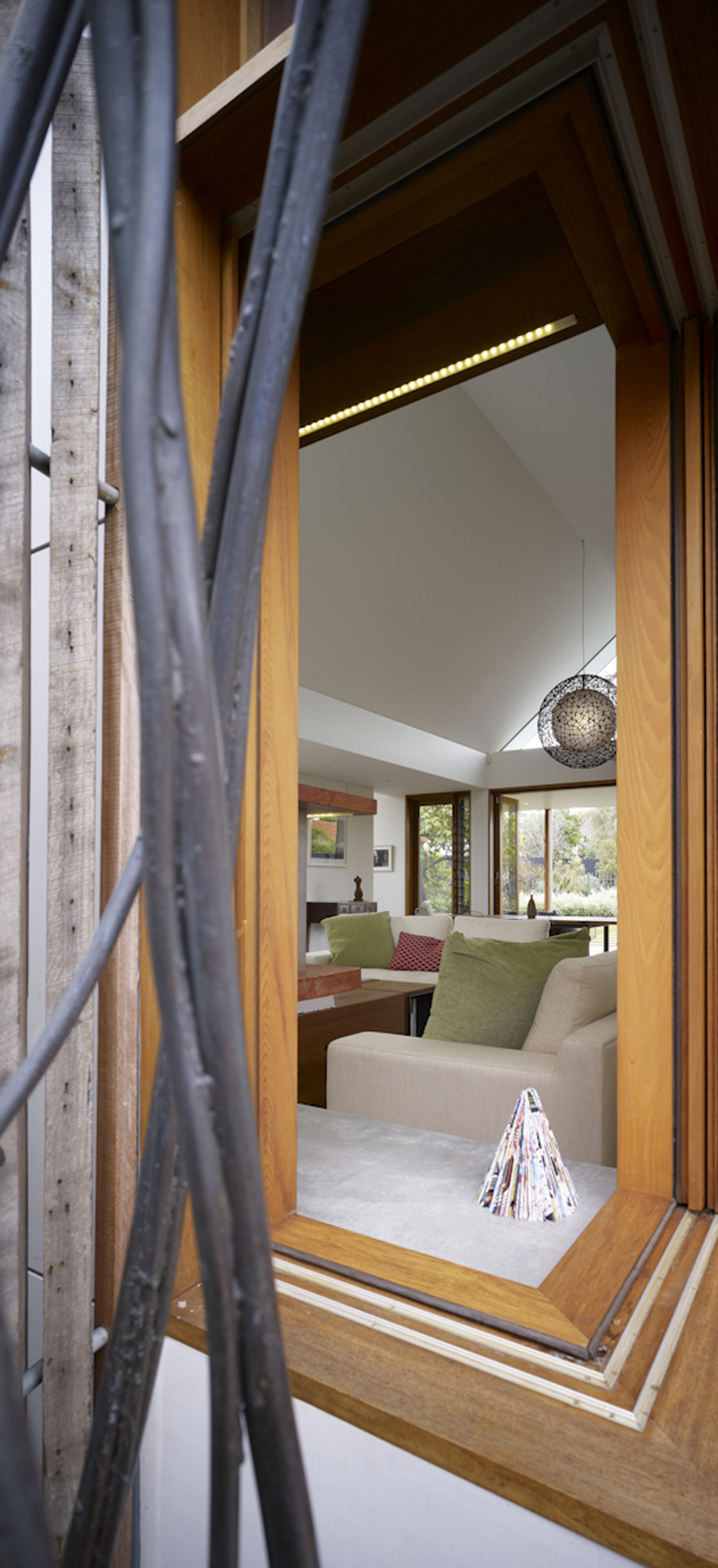 Garrett House by Sydney award winning architecture office Sam Crawford Architects. Timber corner window looking into living room