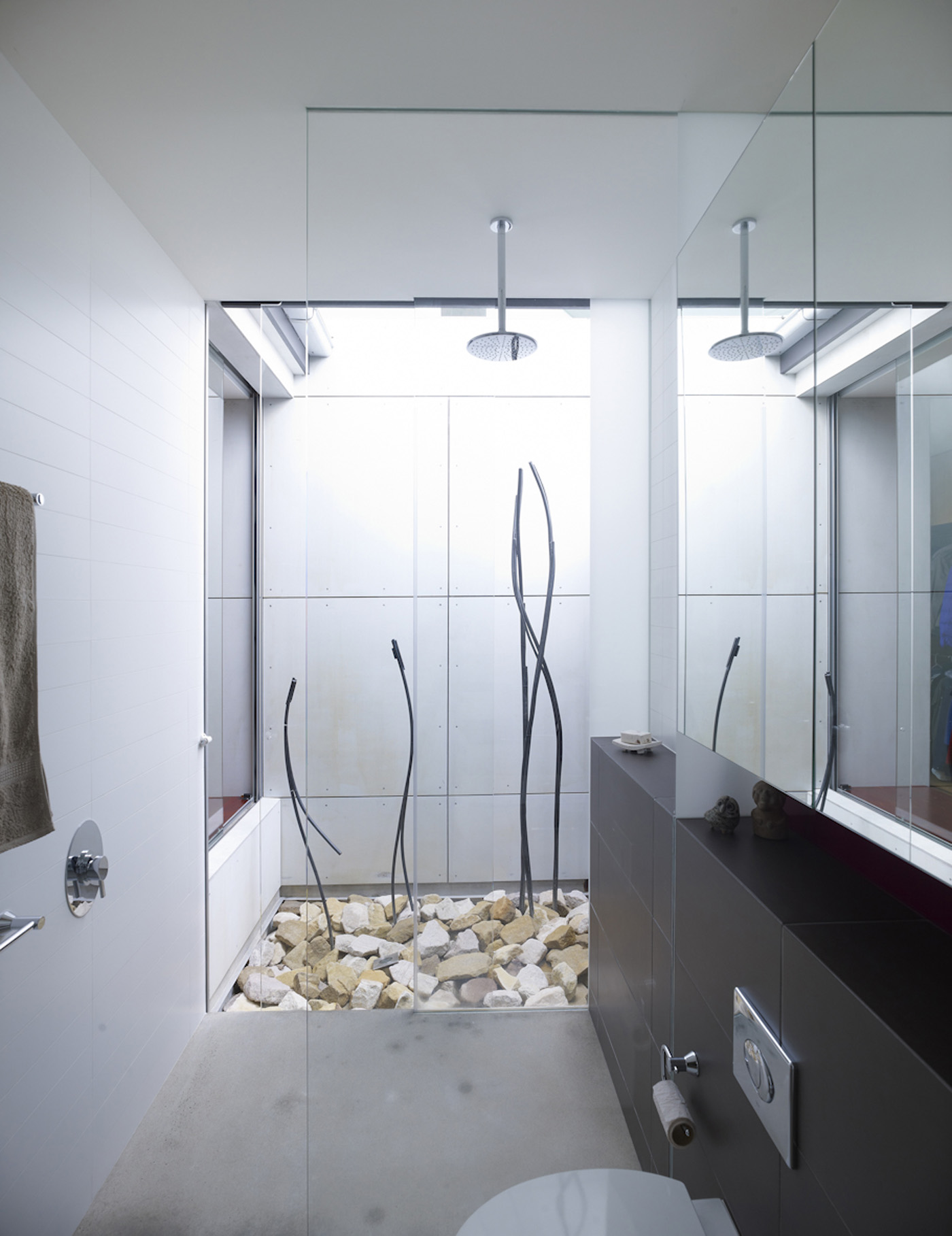 Garrett House by Sydney award winning architecture office Sam Crawford Architects. View to light filled bathroom