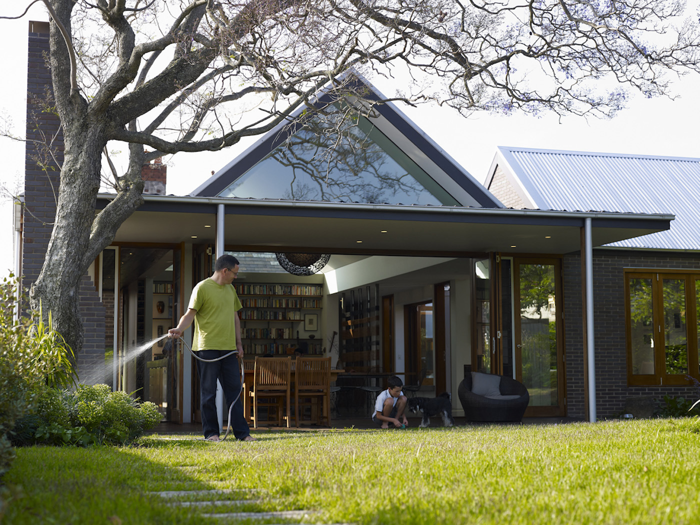 Garrett House by Sydney award winning architecture office Sam Crawford Architects. View into house from backyard
