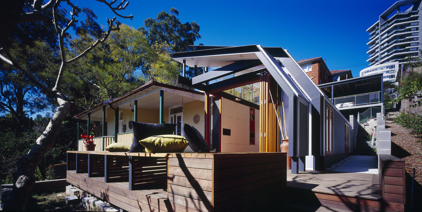 Wave House by Sydney award winning residential architecture firm Sam Crawford Architects. View of raised timber seating from front entry.