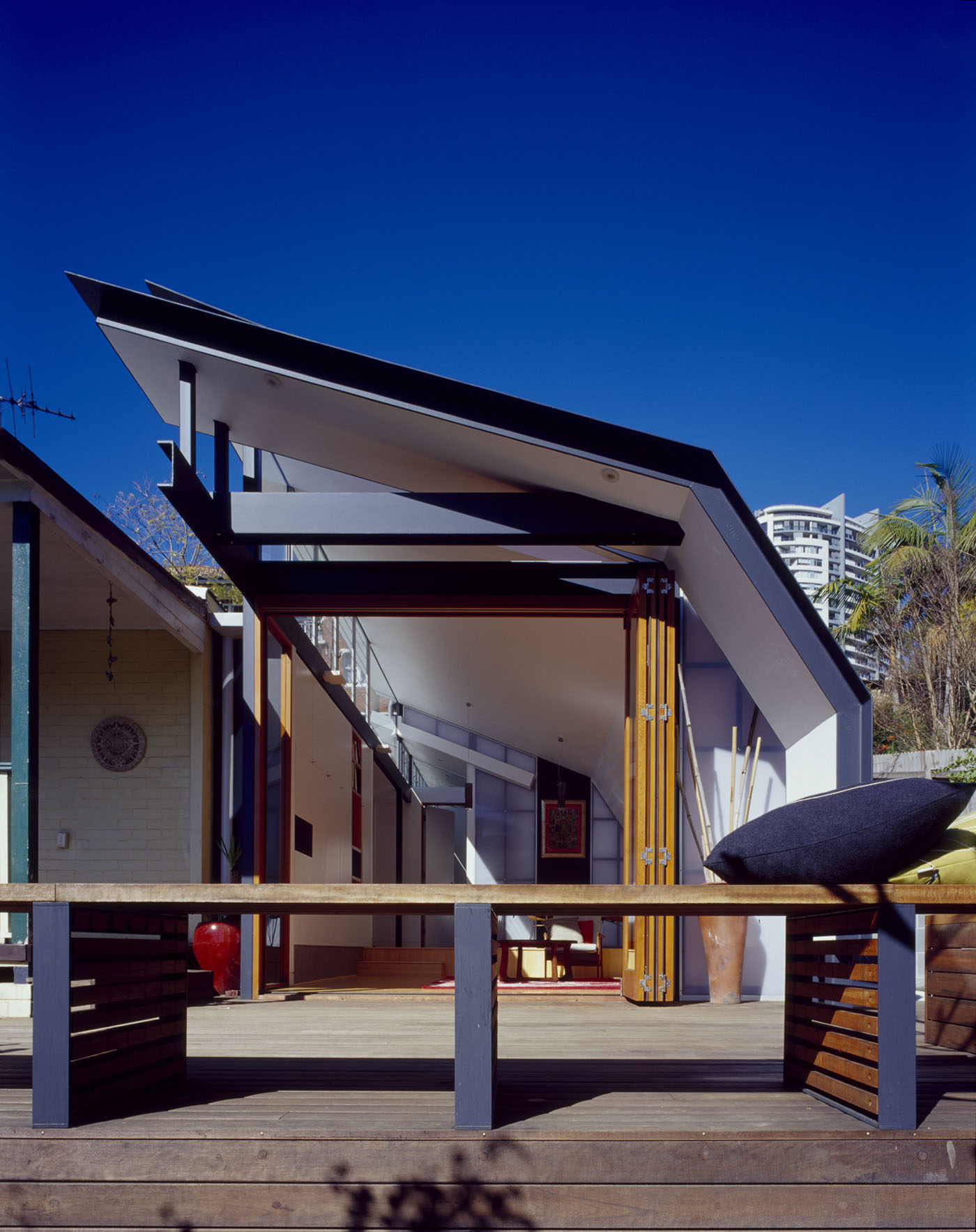 Wave House by Sydney award winning residential architecture firm Sam Crawford Architects. Front view of new addition with folded metal deck roof and clerestory windows