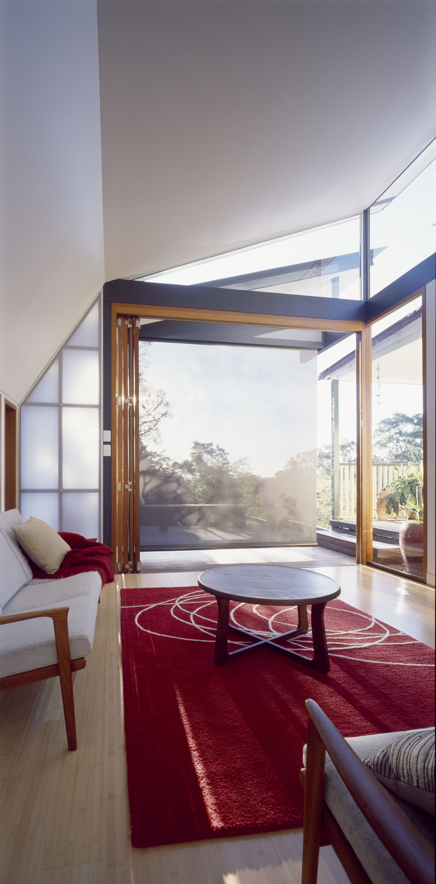Wave House by Sydney award winning residential architecture firm Sam Crawford Architects. Light filtered through glass, Lexan Thermoclear Twin Wall polycarbonate sheeting and blinds.