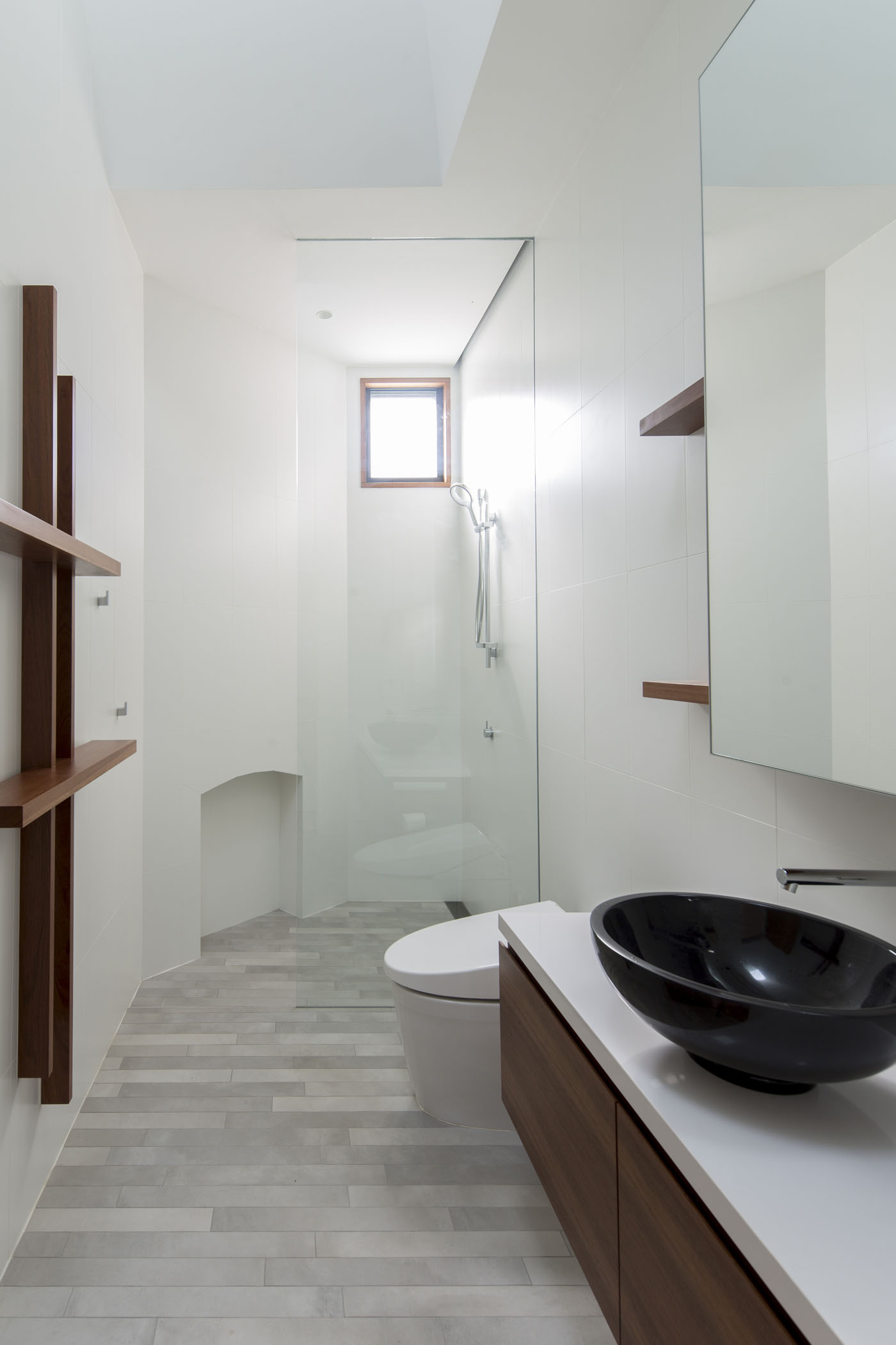 Sheppard Wilson House by Sydney award winning residential architecture office Sam Crawford Architects. Minimal bathroom featuring angular skylight and window