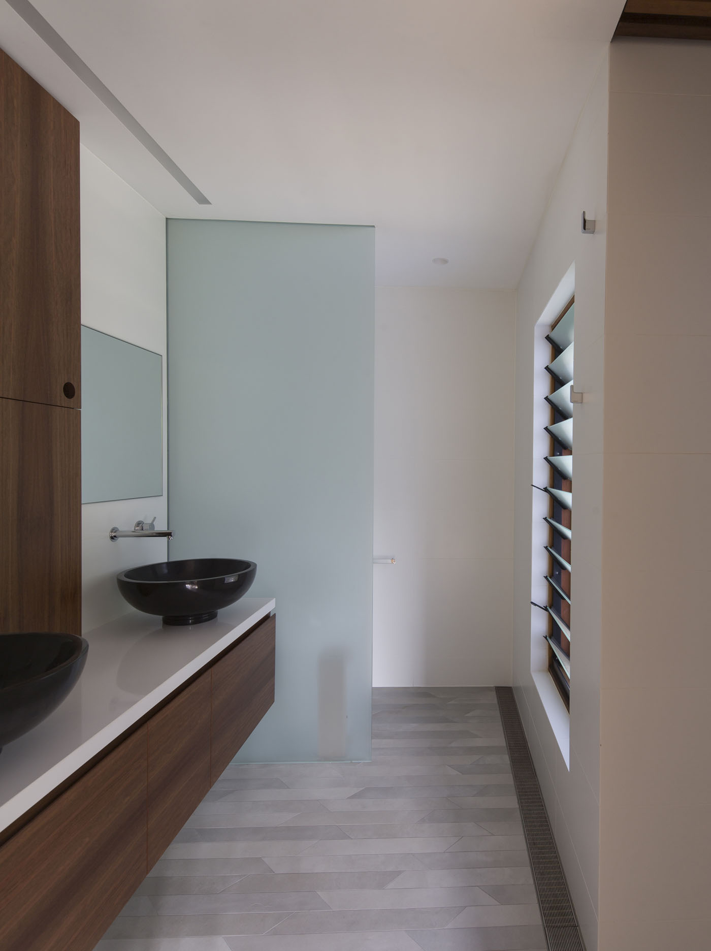 Sheppard Wilson House by Sydney award winning residential architecture office Sam Crawford Architects. Bespoke bathroom featuring geometric floor tiles