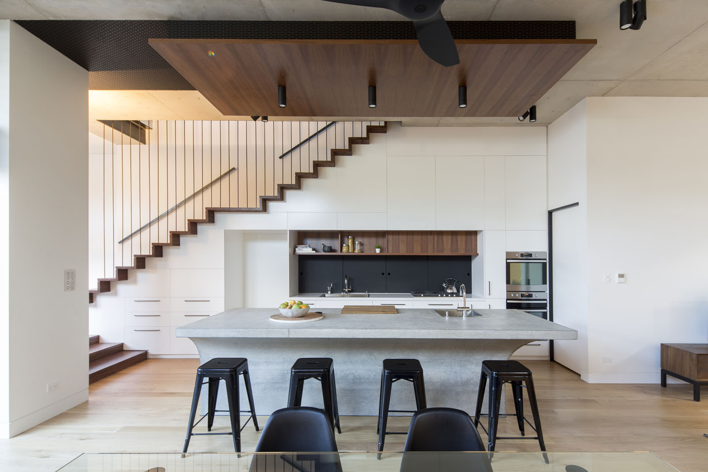 Sheppard Wilson House by Sydney award winning residential architecture office Sam Crawford Architects. Bespoke kitchen featuring concrete bench.