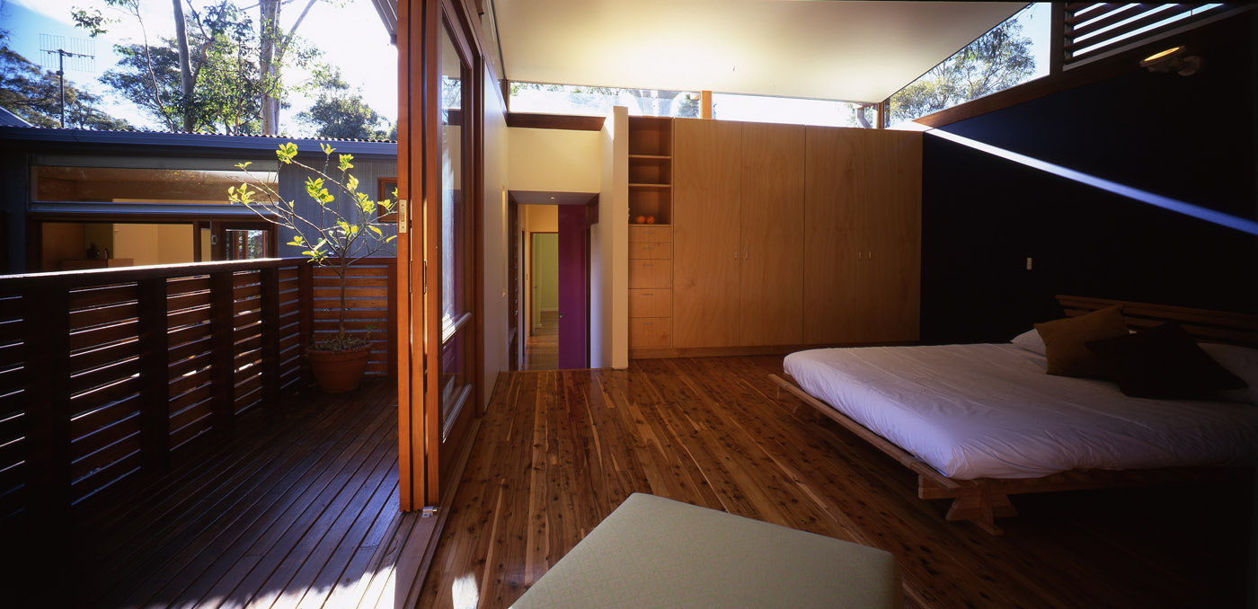 Avalon Beach House by Sydney award winning residential architecture firm Sam Crawford Architects. View of bedroom connection to balcony