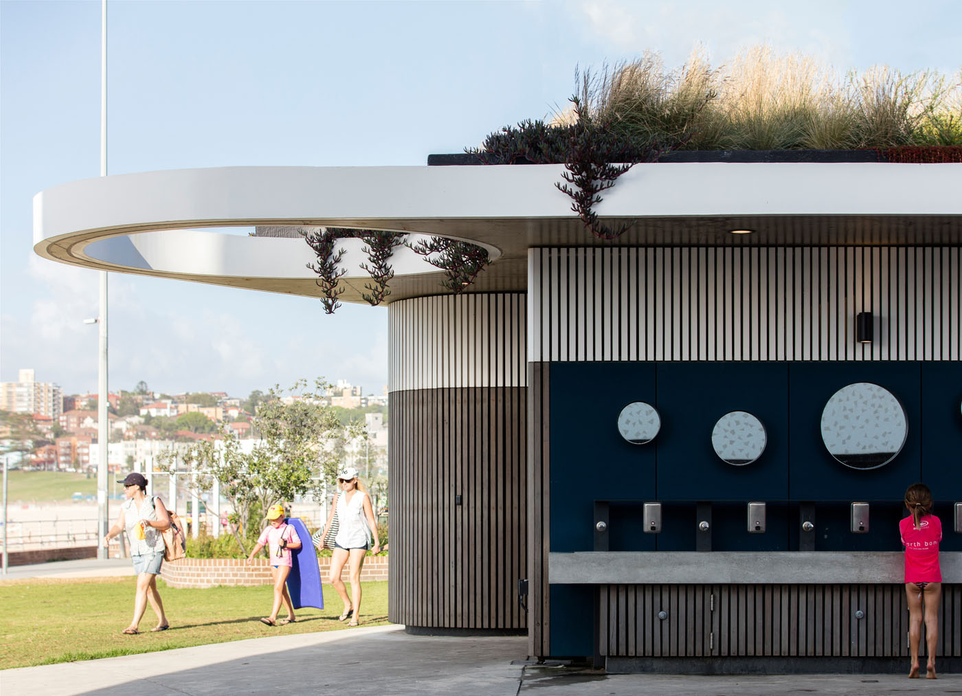 North Bondi Amenities, a public project by award winning Sam Crawford Architects. Clean lines and use of natural timber facade.