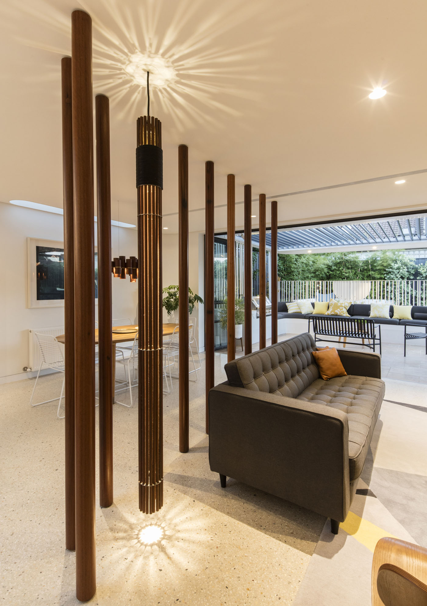 Dover Heights Pendants by award winning Sydney firm Sam Crawford Architects. Custom design recycled pendant light gives characteristic to open living space