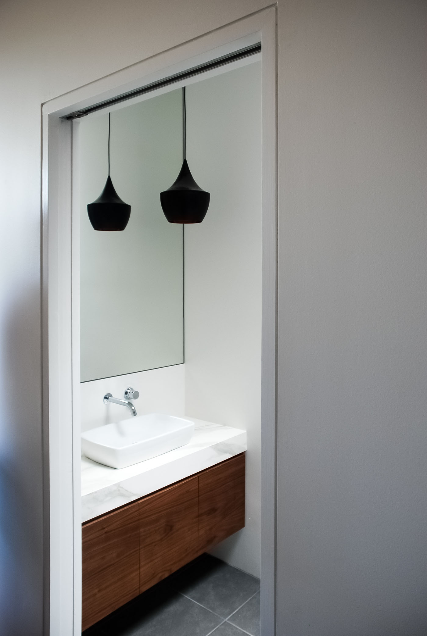 Roseville House by Sydney residential architects Sam Crawford Architects. Here shown a look into the modern bathroom.