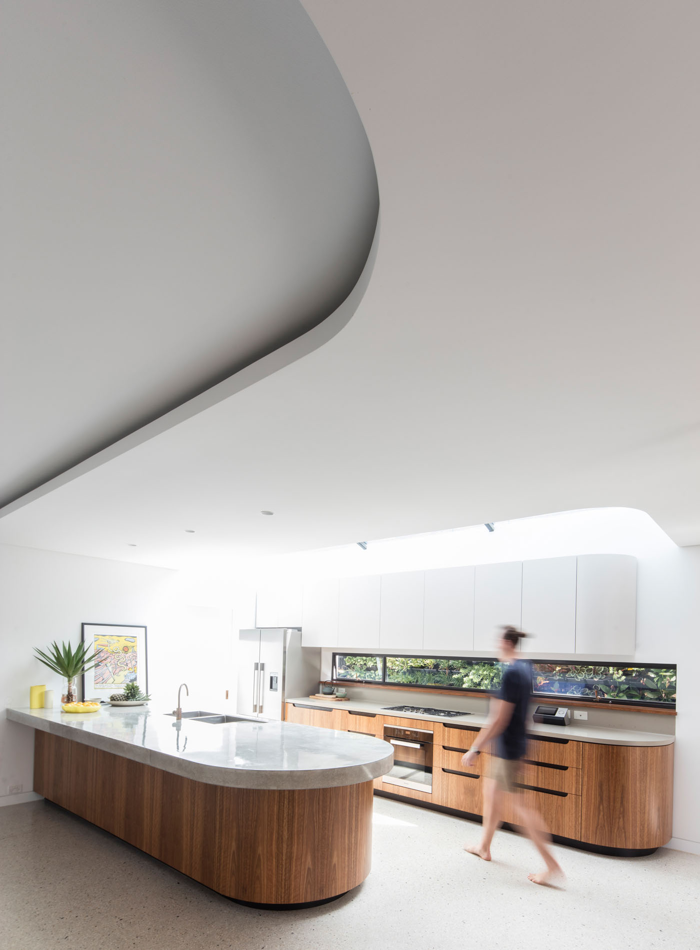 Conway Atkins House in Dover Heights by Sydney architect Sam Crawford Architect. The curves of the joinery and kitchen bench are reflected in the ceiling.