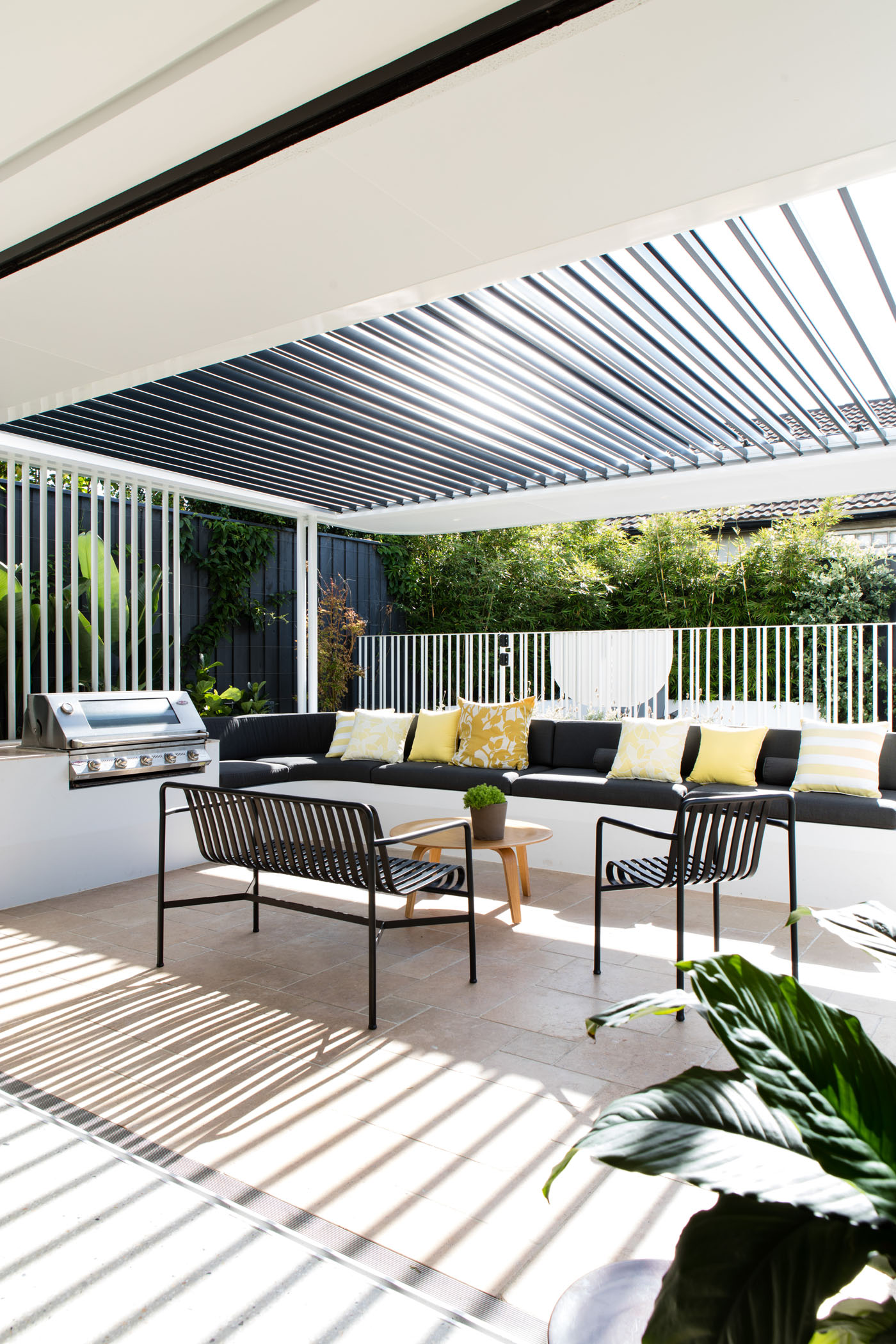 Conway Atkins House in Dover Heights by Sydney architect Sam Crawford Architect. An adjustable pergola protects the occupants from the harsh conditions.