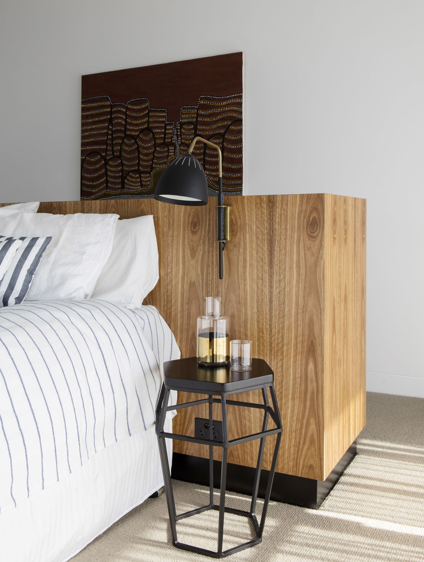 Conway Atkins House in Dover Heights by Sydney architect Sam Crawford Architect. A low joinery piece forms a bed head whilst providing much needed storage.