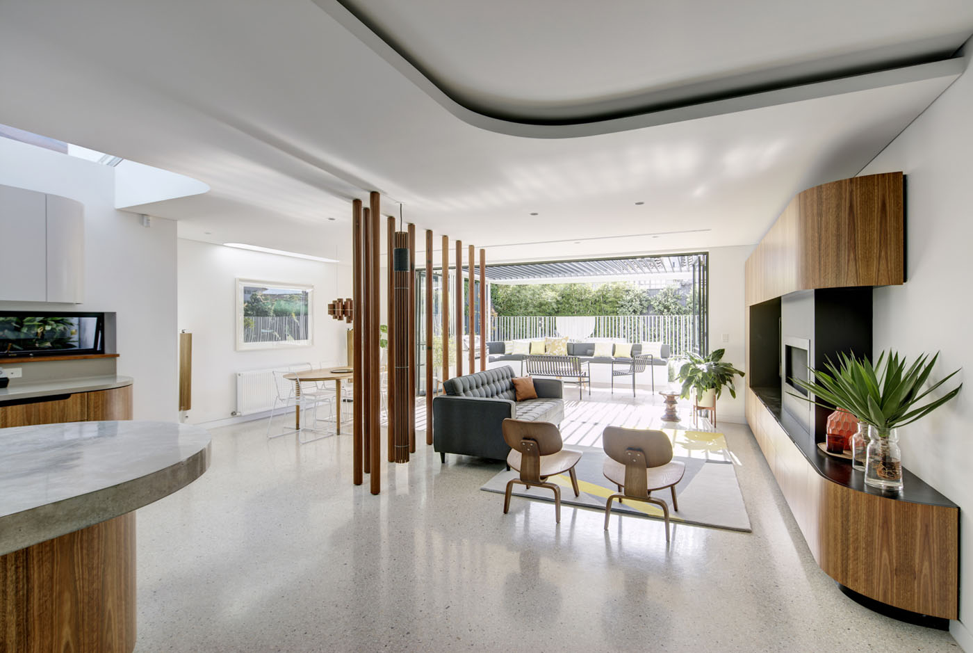 Conway Atkins House in Dover Heights by Sydney architect Sam Crawford Architect. The polished concrete floor reflects light from the yard.