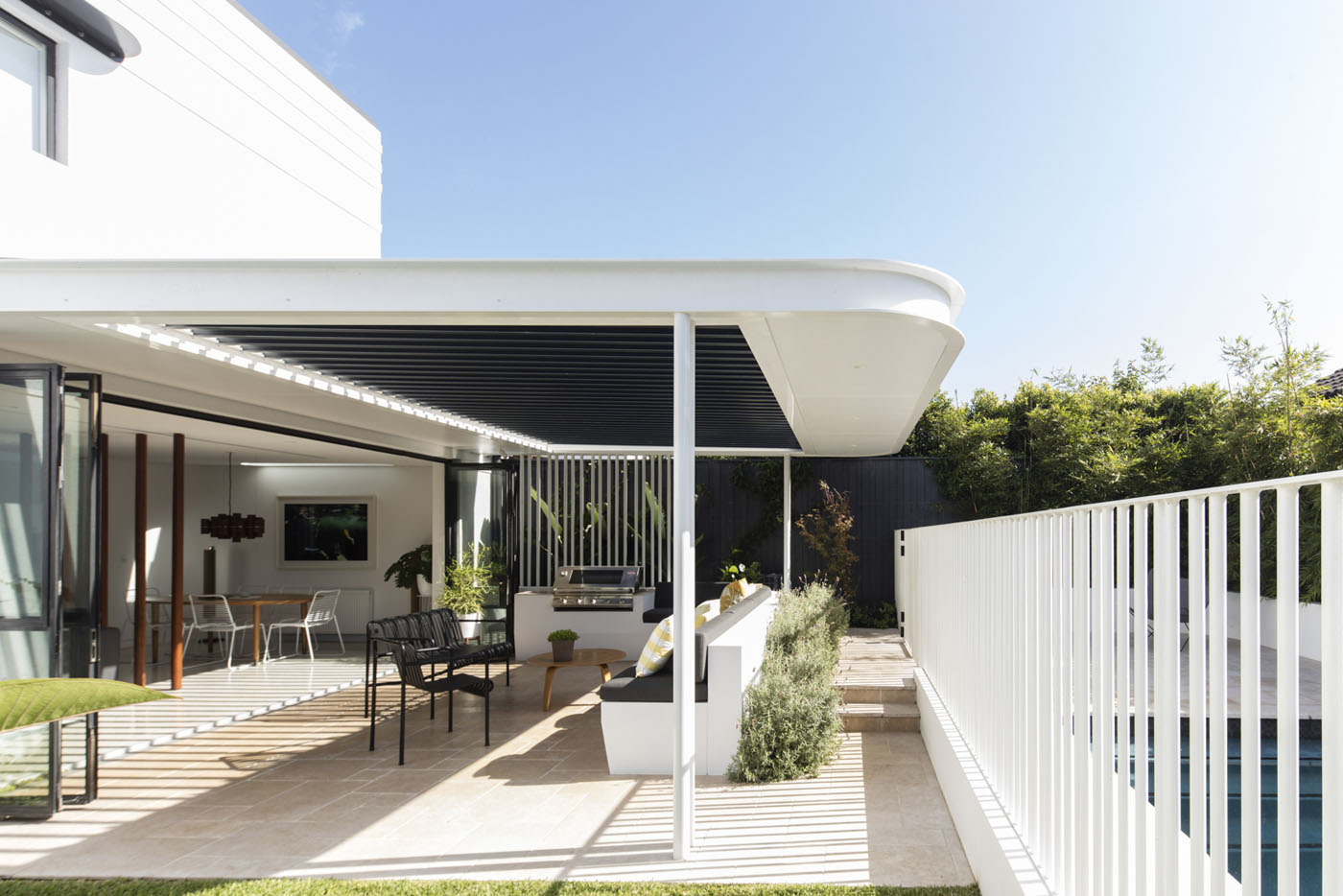Conway Atkins House in Dover Heights by Sydney architect Sam Crawford Architect. The yard has been re-landscaped creating an oasis from Sydney's busy lifestyle.