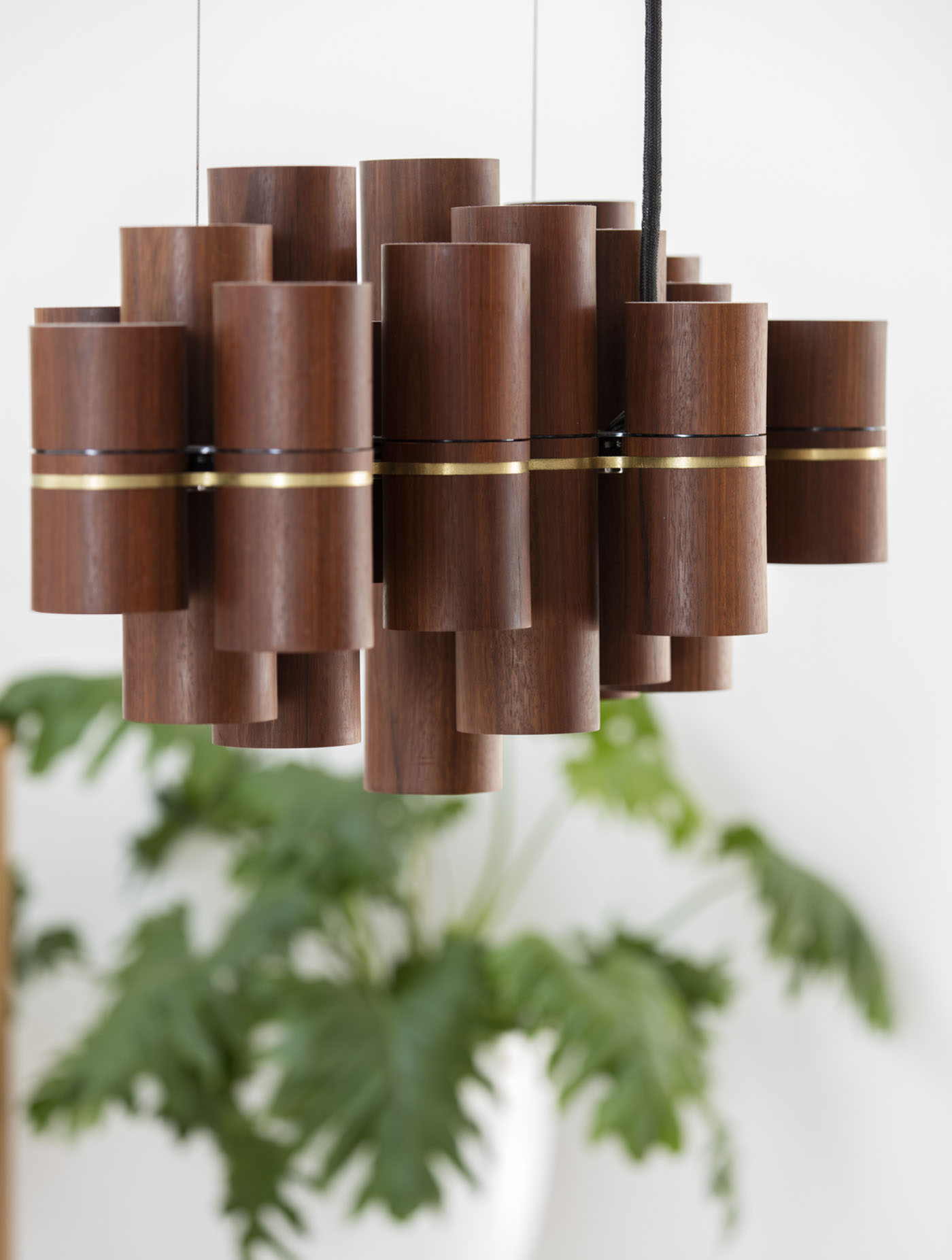Dover Heights Pendants by award winning Sydney firm Sam Crawford Architects. Timber column offcuts are recycled into modern pendant light.
