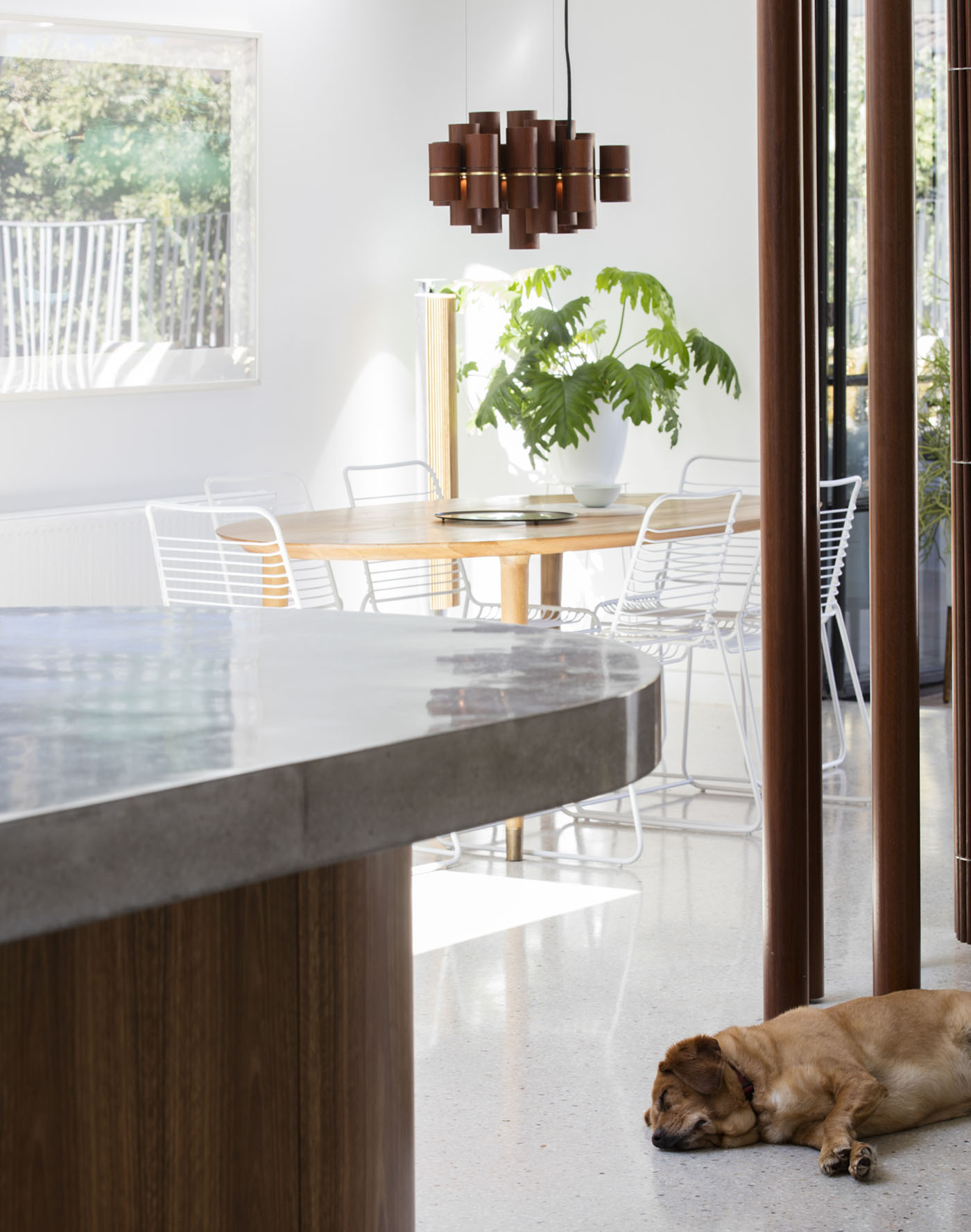 Dover Heights Pendants by award winning Sydney firm Sam Crawford Architects. The minimal interior with custom designed pendant cluster.