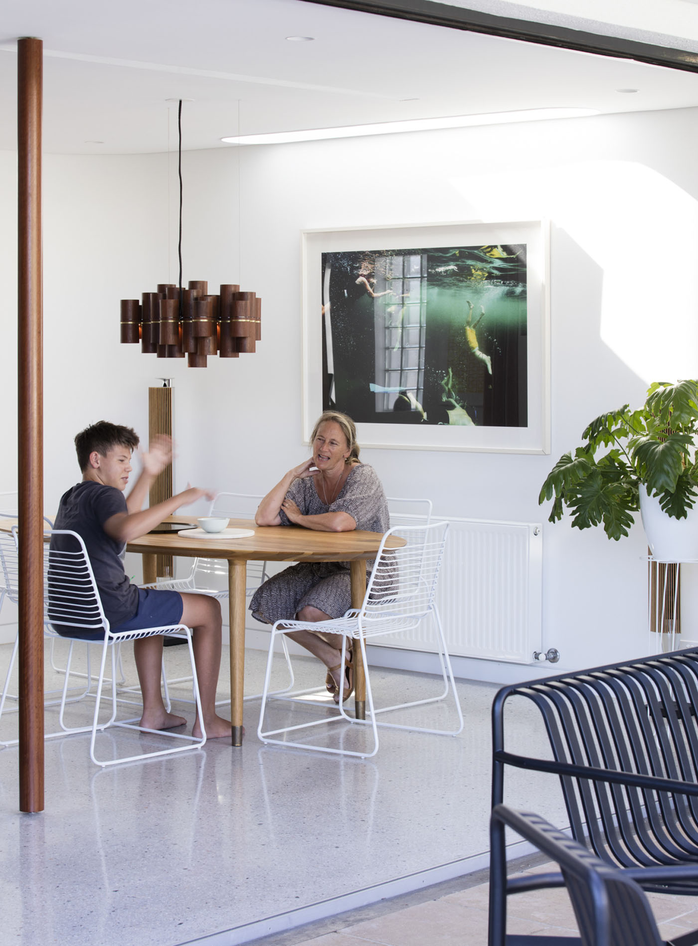 Dover Heights Pendants by award winning Sydney firm Sam Crawford Architects. View into open dining space with pendant above.