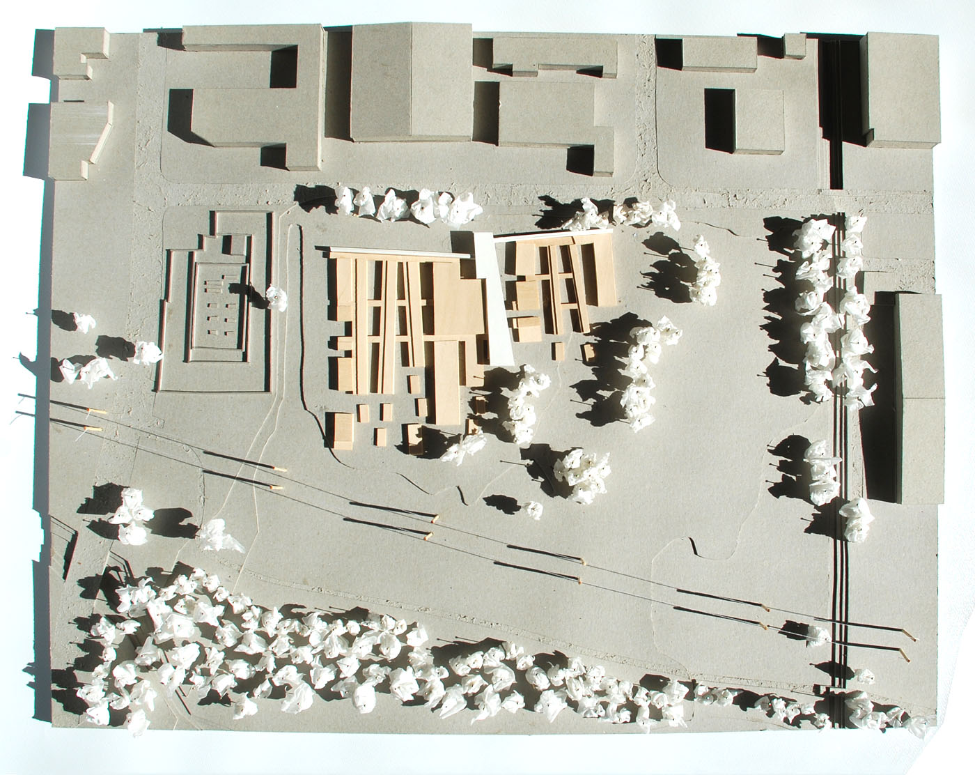 The Shelter by Sam Crawford Architects, grey boxboard and basswood site model
