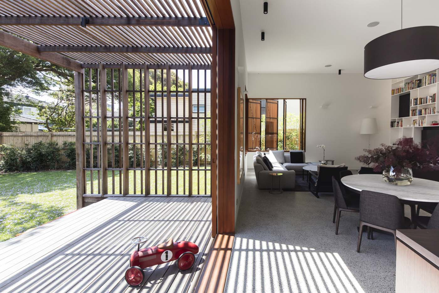 Sung Dobson house by Sam Crawford Architects, Sydney. Living area leading onto deck.
