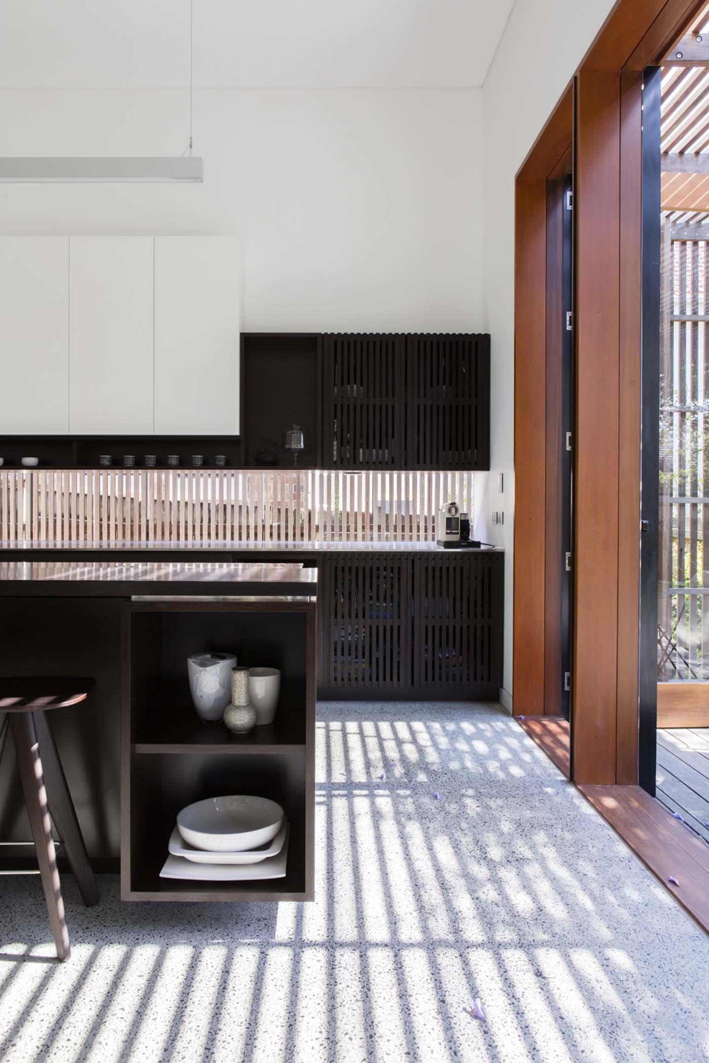 Sung Dobson house by Sam Crawford Architects, Sydney. Modern open-plan kitchen.