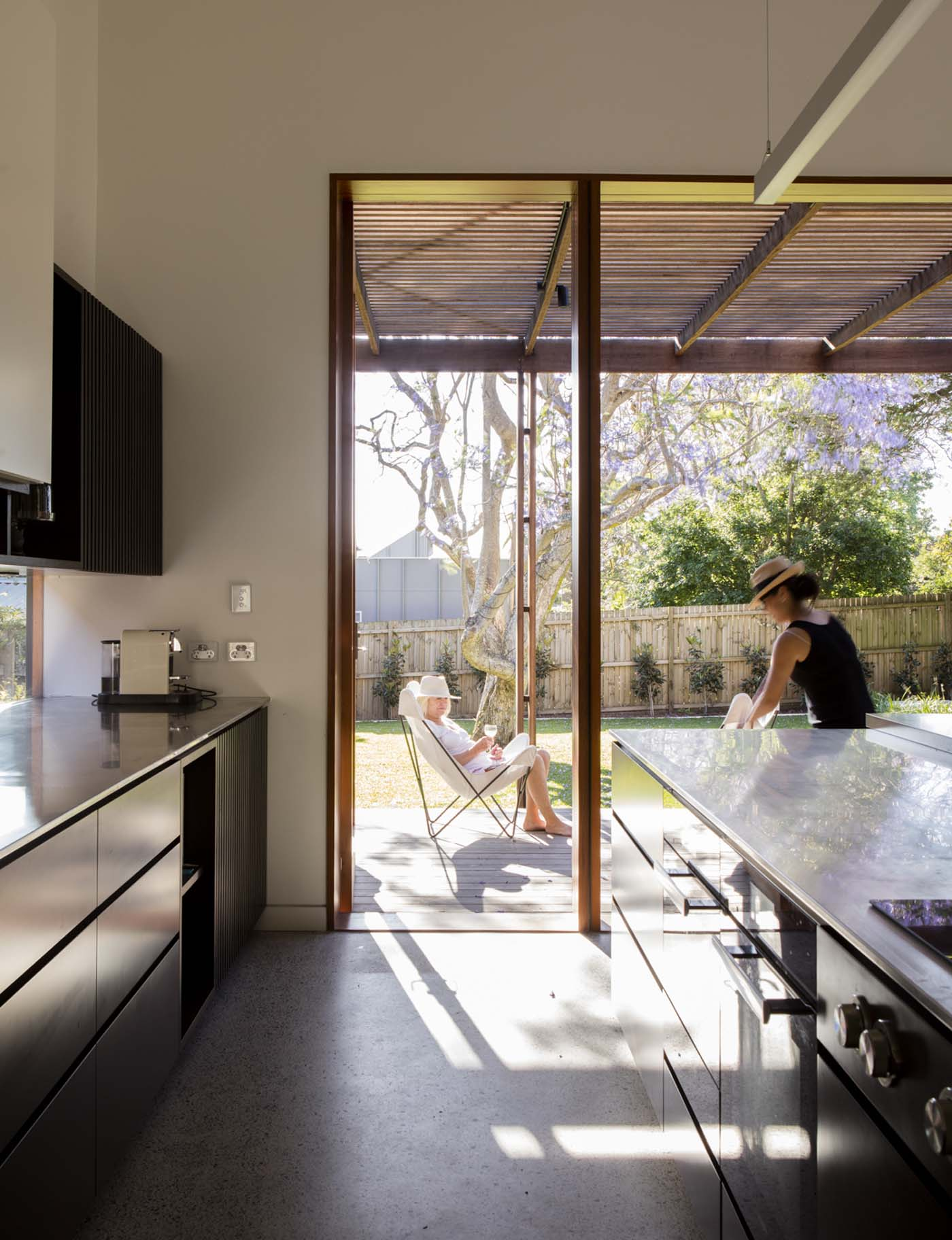 Sung Dobson house by Sam Crawford Architects, Sydney. Generous kitchen leads on to the deck.