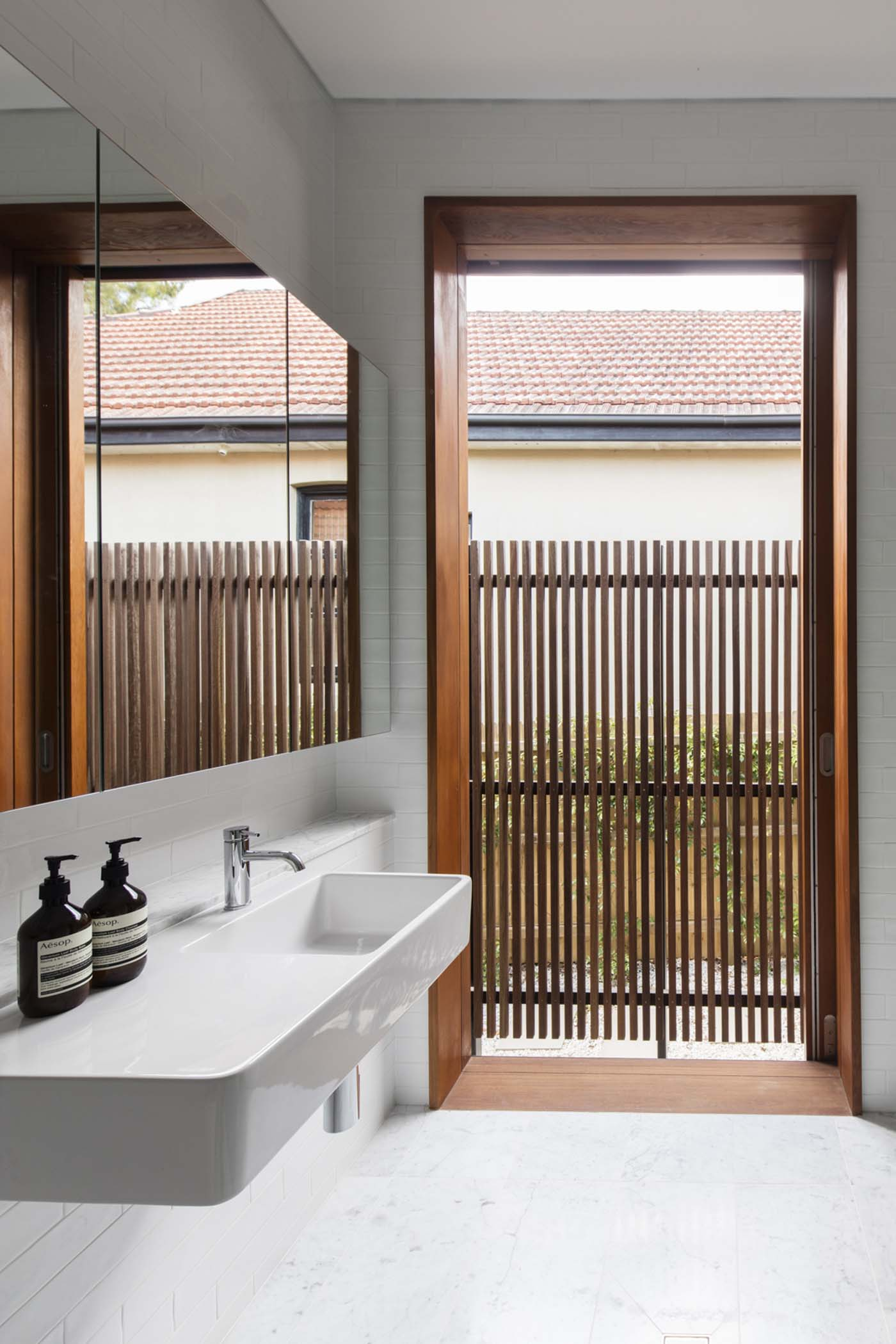 Sung Dobson house by Sam Crawford Architects, Sydney. Bathroom with outdoor access.