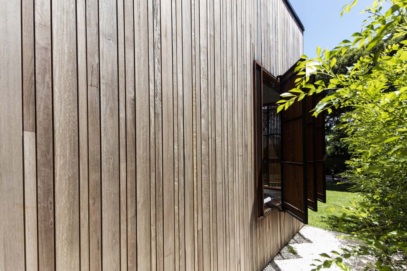 Sung Dobson house by Sam Crawford Architects, Sydney. Timber casement shutters.