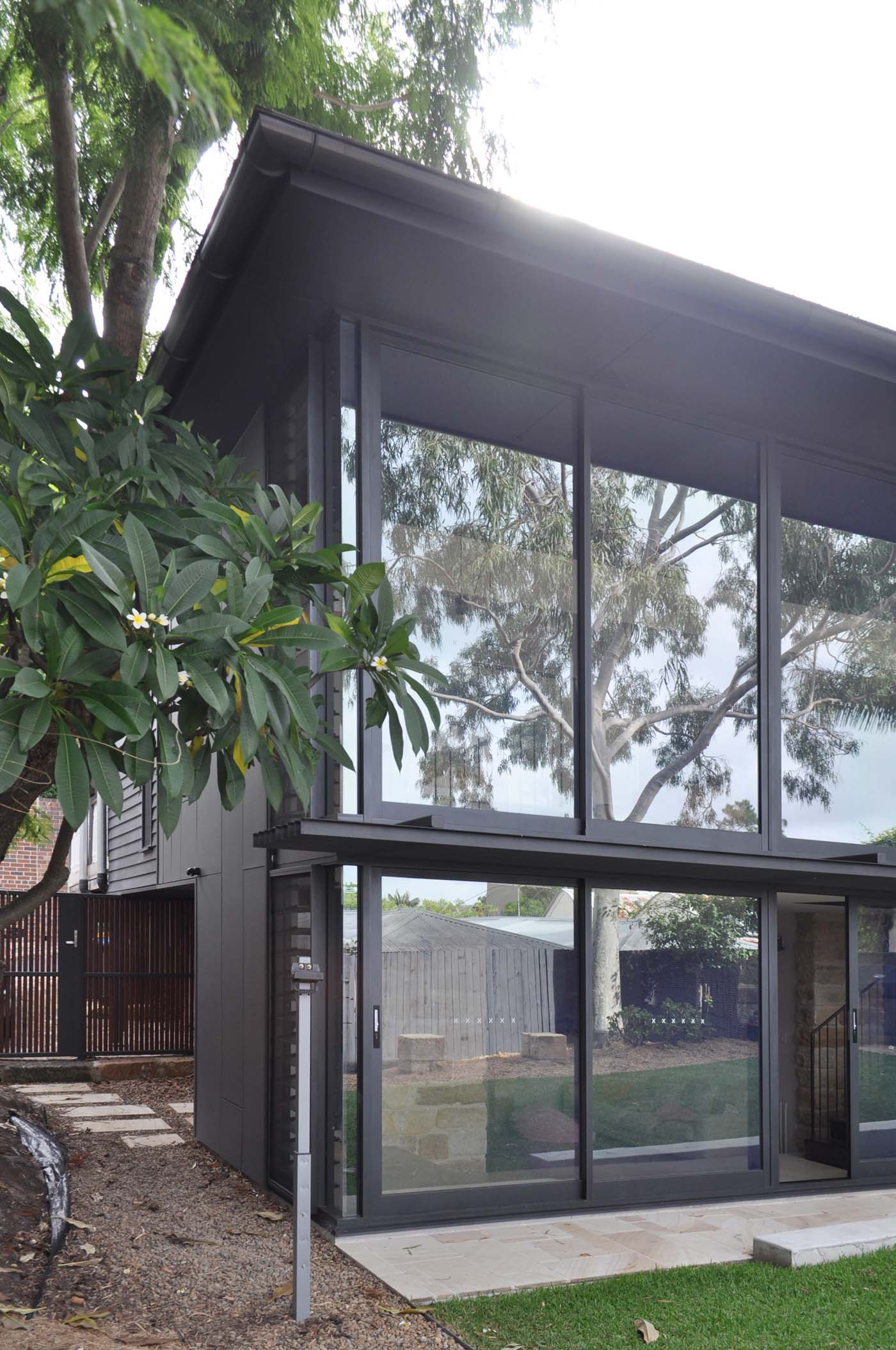 Balmain Cottage by award winning Sydney firm Sam Crawford Architects. View from backyard to large glass façade connecting the interior and exterior