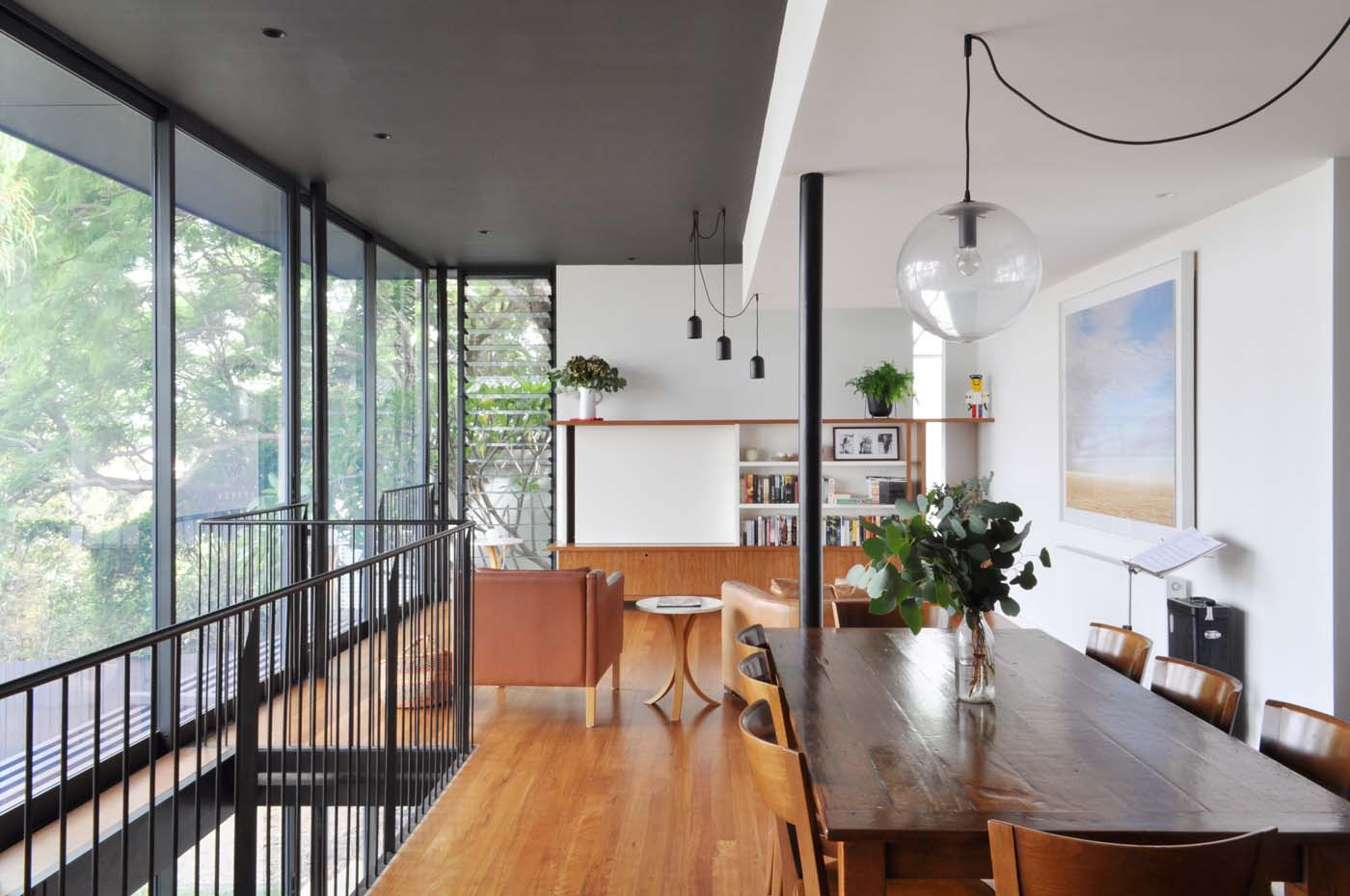 Balmain Cottage by award winning Sydney firm Sam Crawford Architects. View to light-filled open interior with full height windows looking out to the backyard.