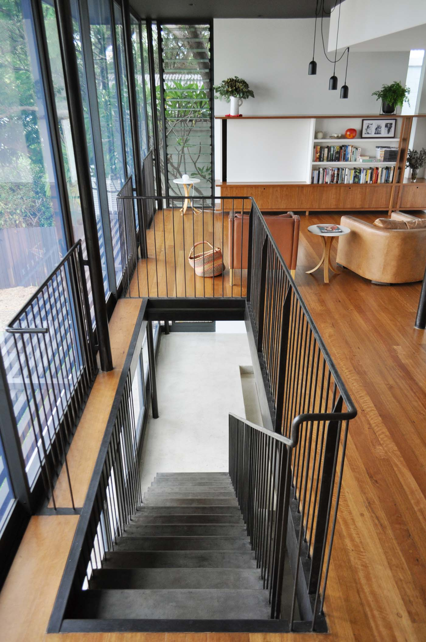 Balmain Cottage by award winning Sydney firm Sam Crawford Architects. View to folded raw steel staircase and black powder coated handrail