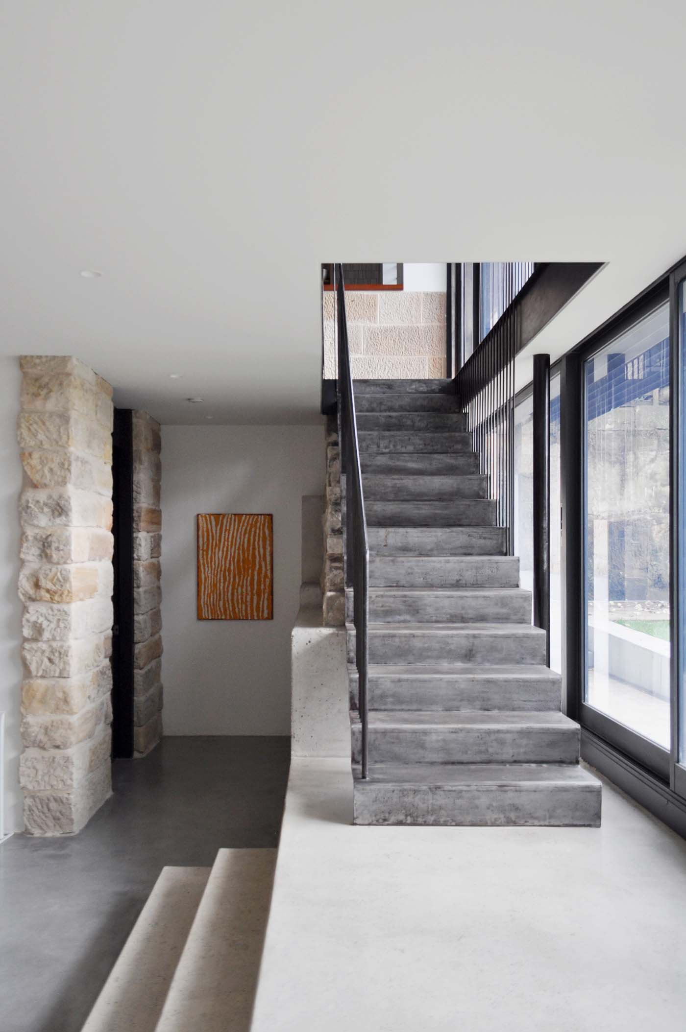 Balmain Cottage by award winning Sydney firm Sam Crawford Architects. Modern raw steel staircase within heritage listed house
