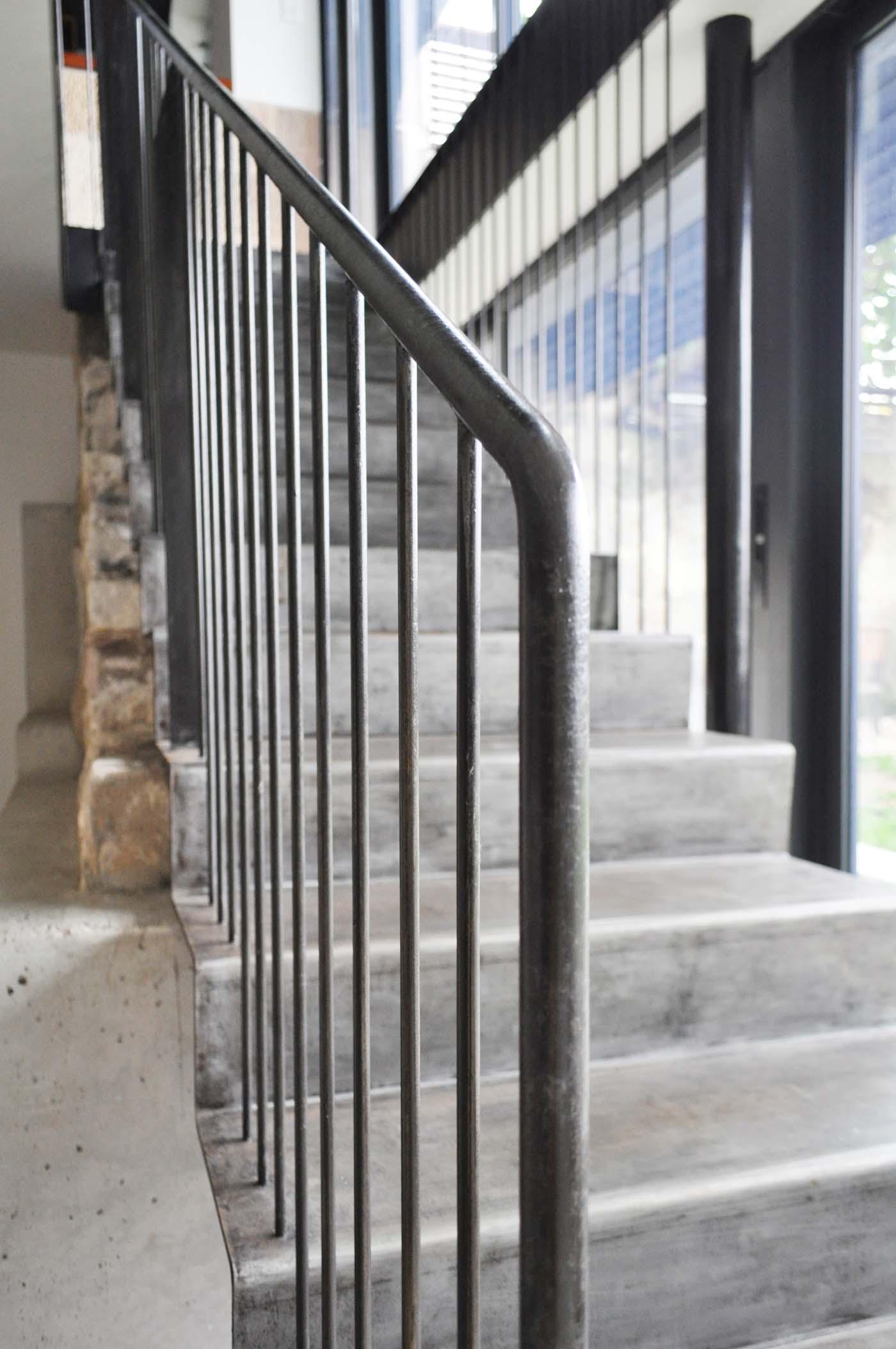 Balmain Cottage by award winning Sydney firm Sam Crawford Architects. Detail of tubular black steel handrail with balustrade
