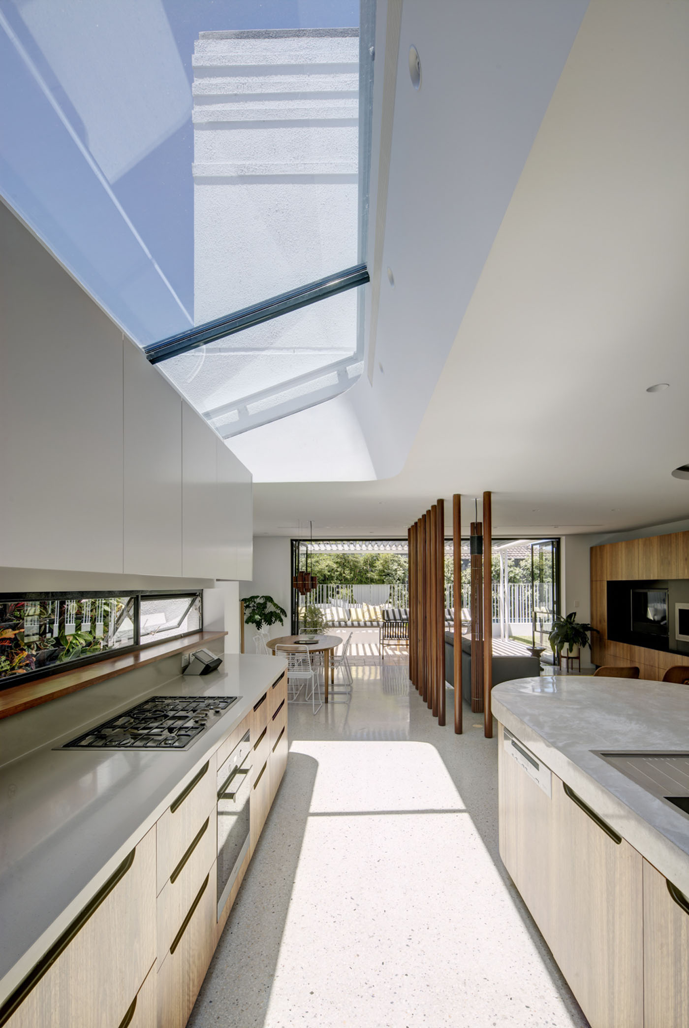 Conway Atkins House in Dover Heights by Sydney architect Sam Crawford Architect. The new kitchen utilises a glass roof to bring light into the living areas.