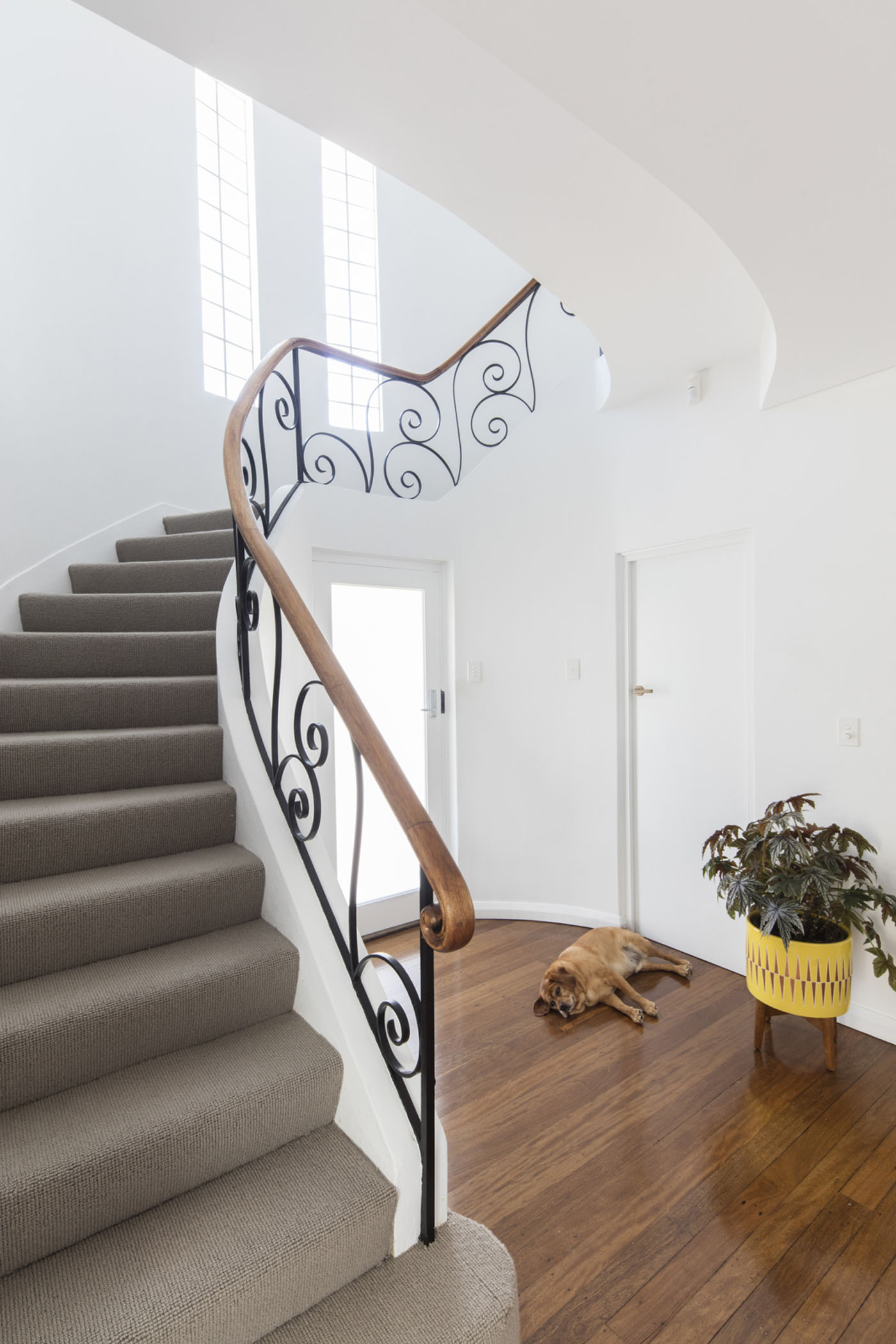 Conway Atkins House in Dover Heights by Sydney architect Sam Crawford Architect. The existing stairwell has been retained and refurbished.