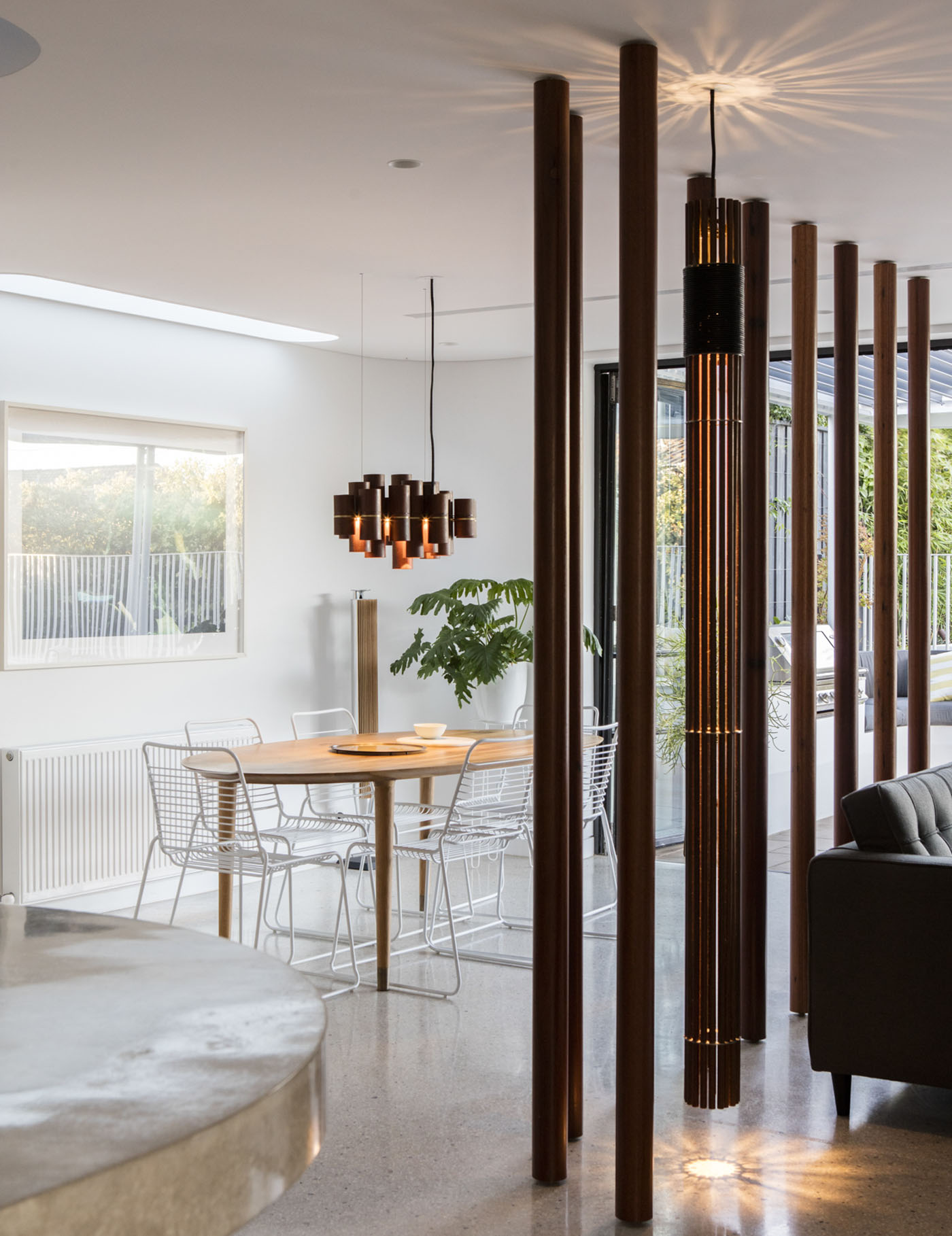 Conway Atkins House in Dover Heights by Sydney architect Sam Crawford Architect. Two different custom lights decorate the living spaces.