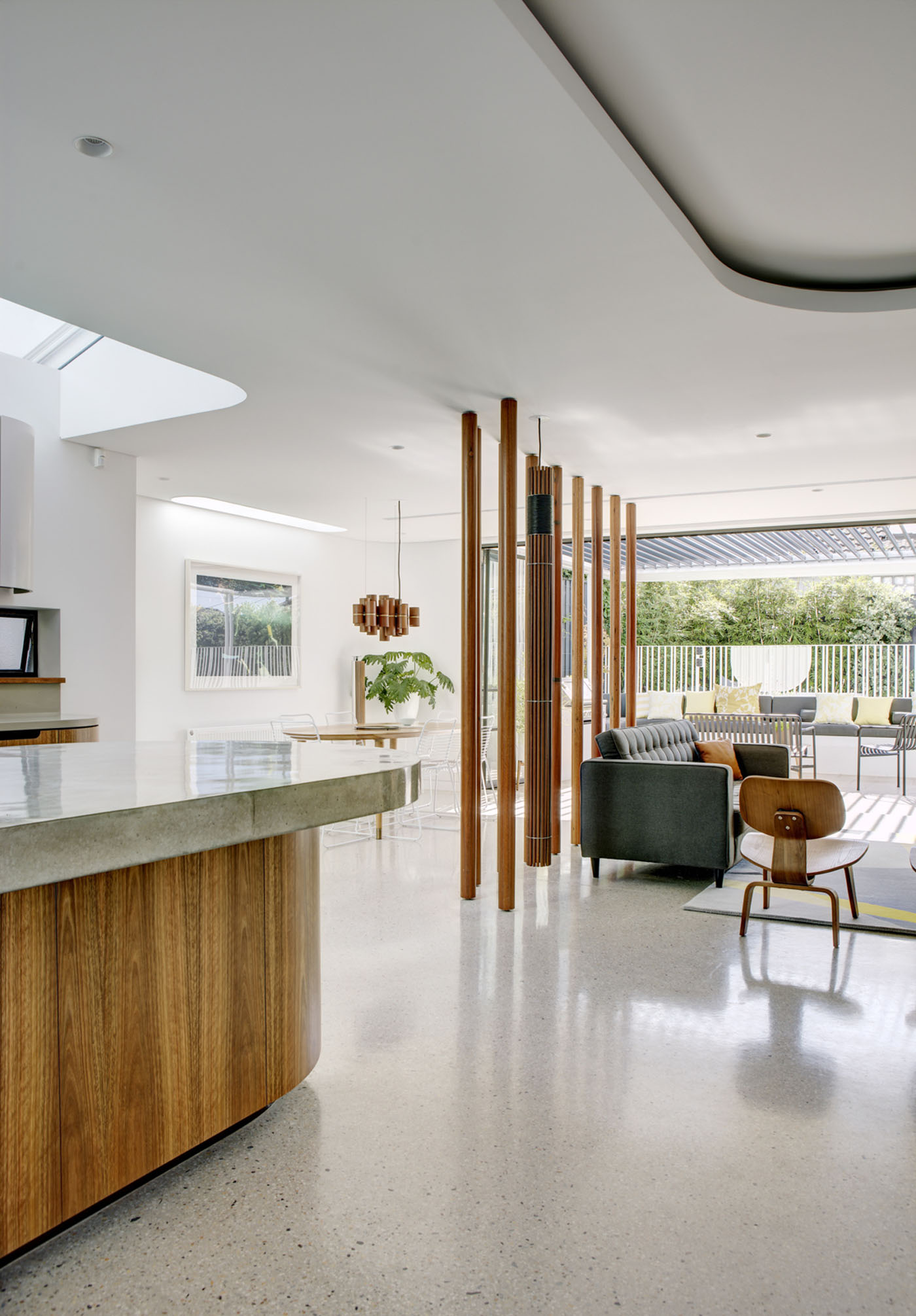 Conway Atkins House in Dover Heights by Sydney architect Sam Crawford Architect. Polished concrete is used throughout the living areas and kitchen bench.