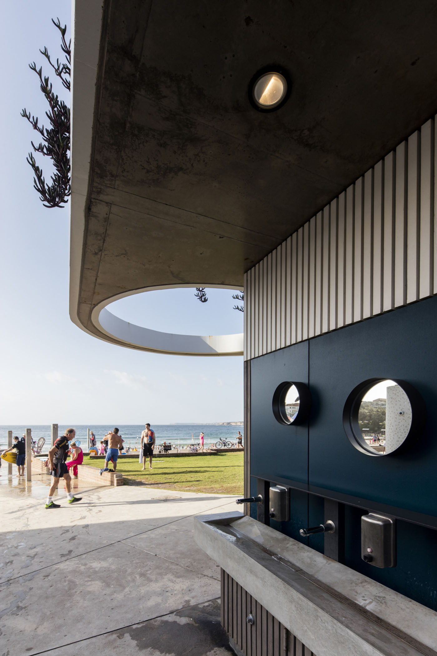 North Bondi Amenities, a public project by award winning Sam Crawford Architects. View out to the beach from the hand basins.
