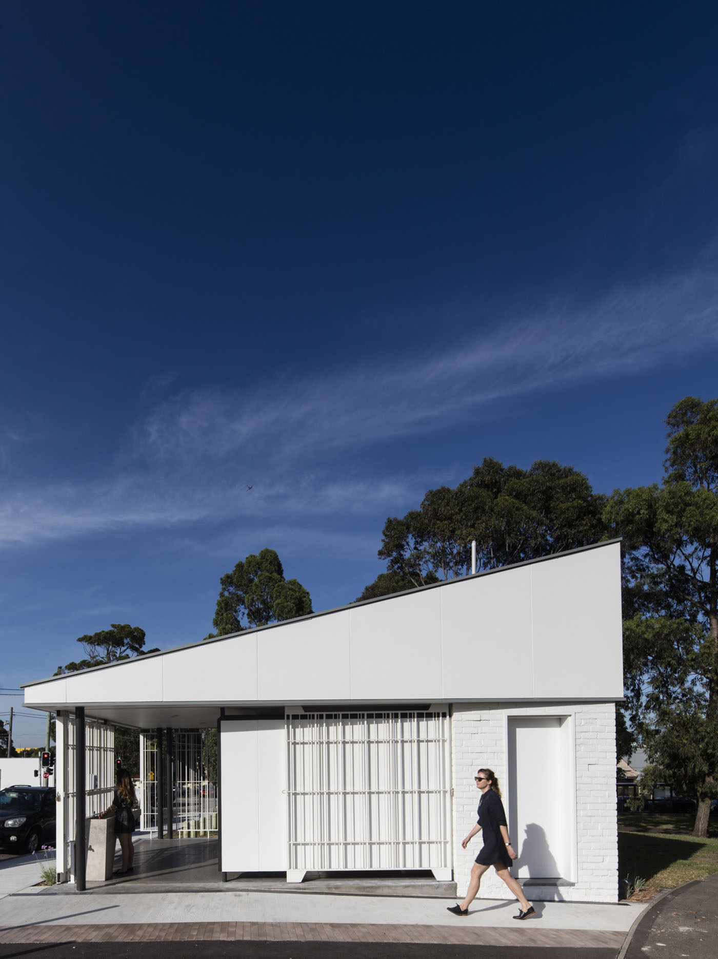 Sydenham Green Amenities by Sam Crawford Architects, Sydney. Angular form reference planes flying overhead.