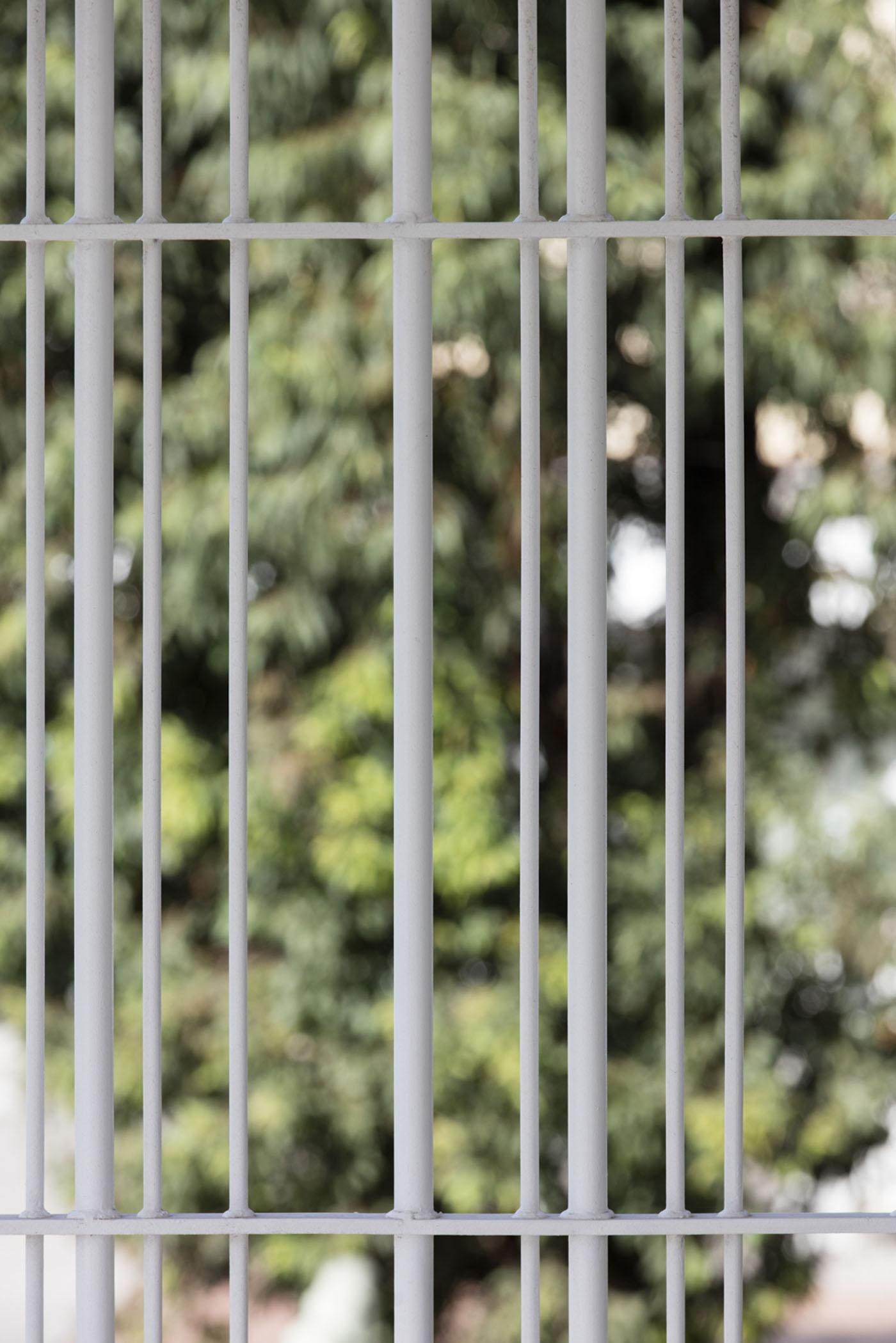 Sydenham Green Amenities by Sam Crawford Architects, Sydney. Steel security gates.