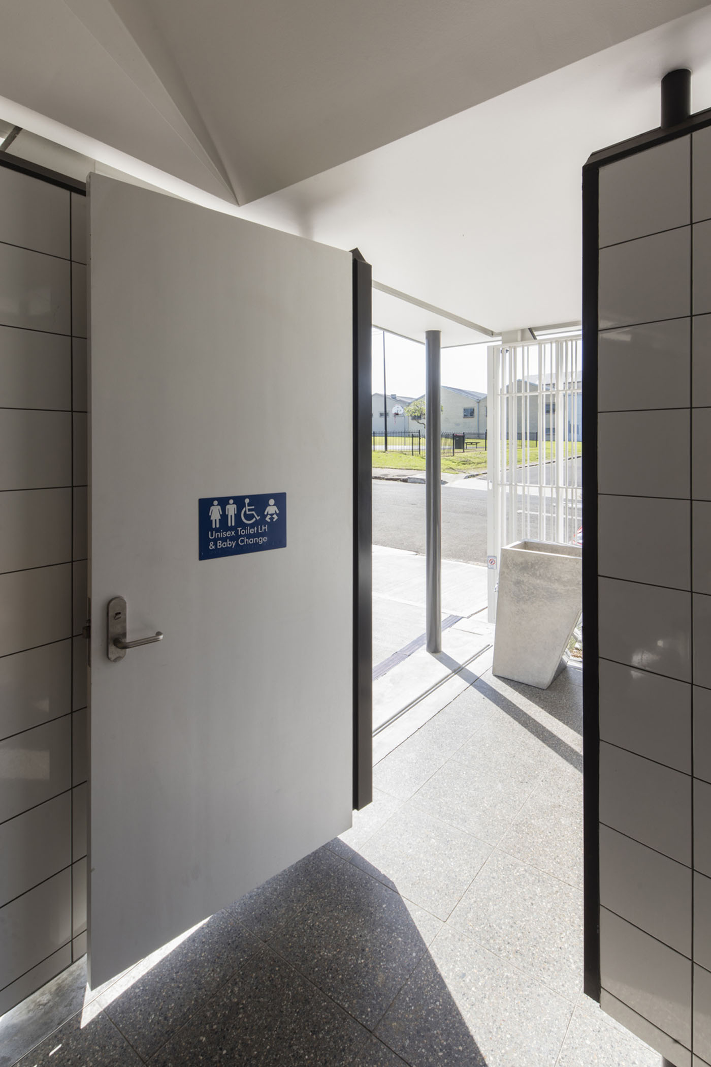 Sydenham Green Amenities by Sam Crawford Architects, Sydney. Accessible toilets.